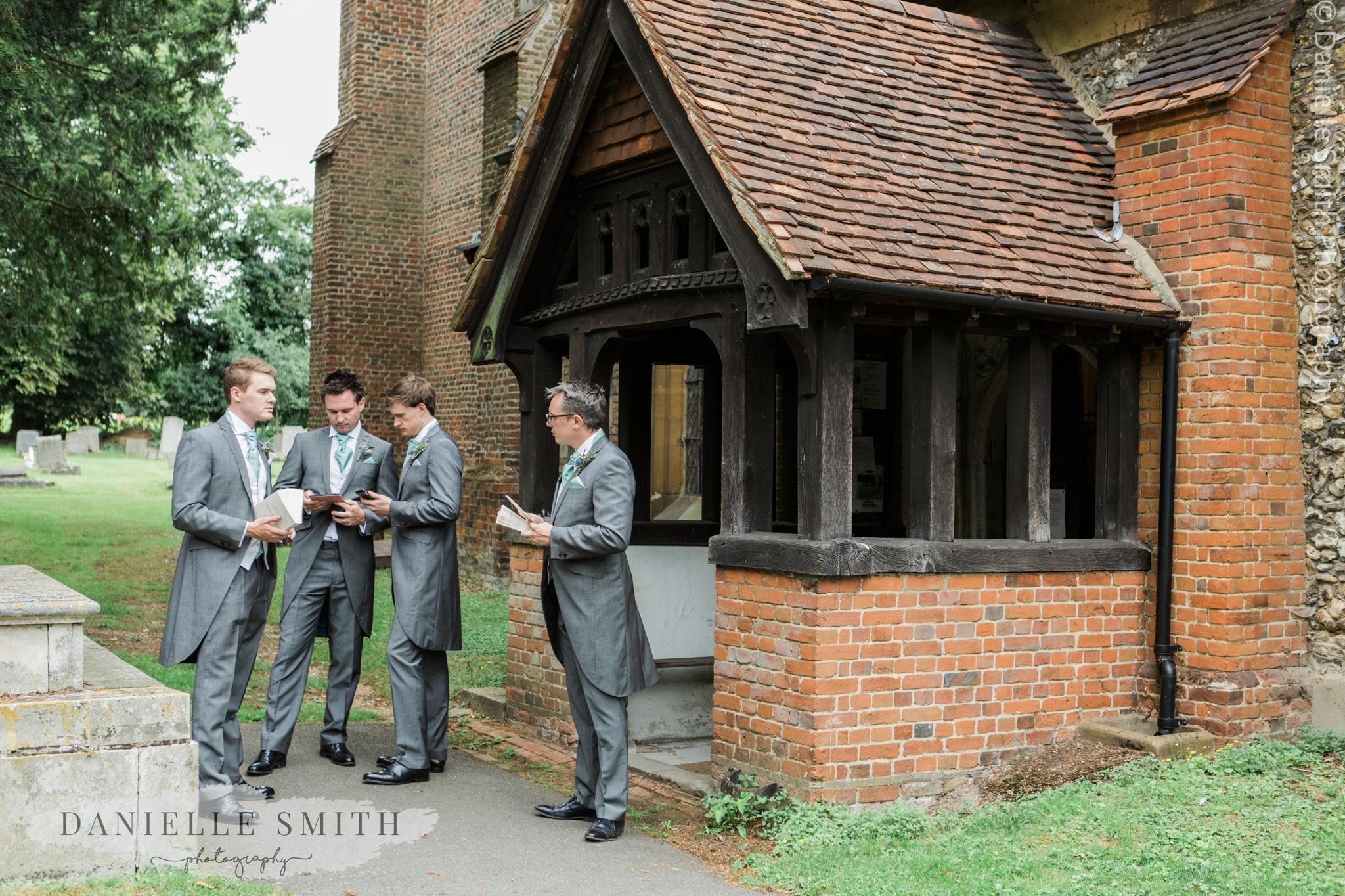 groom and groomsmen waiting outside church