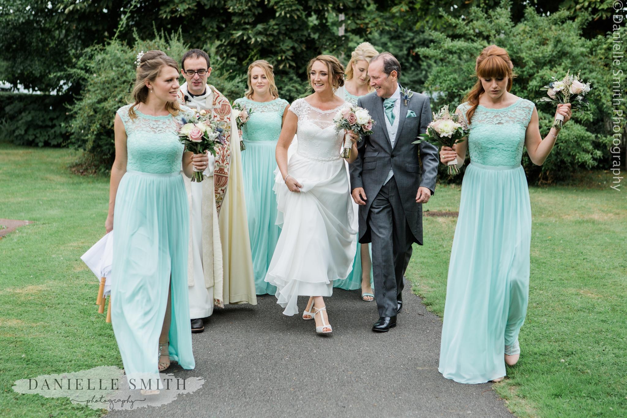 bride and bridesmaids walking to church