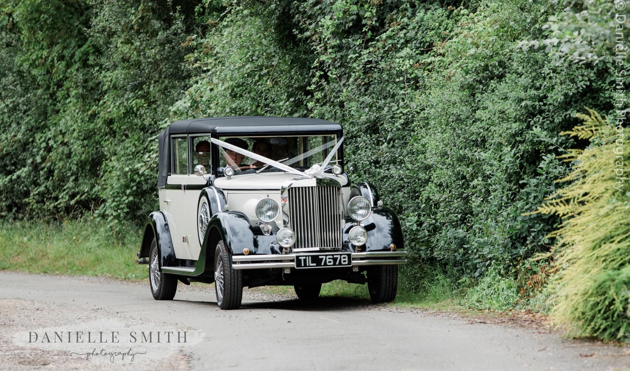 vintage wedding car arriving at church