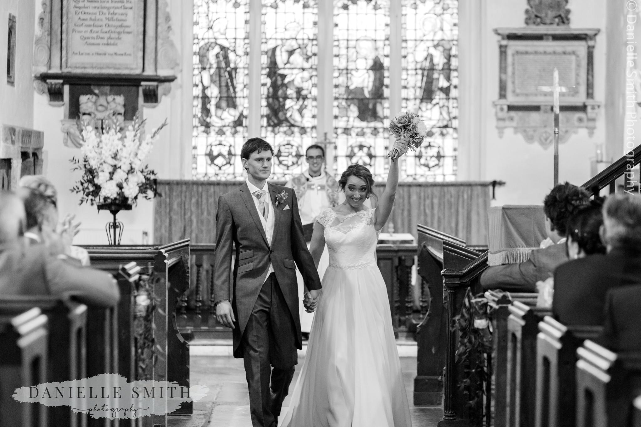 bride cheering as the walk down aisle