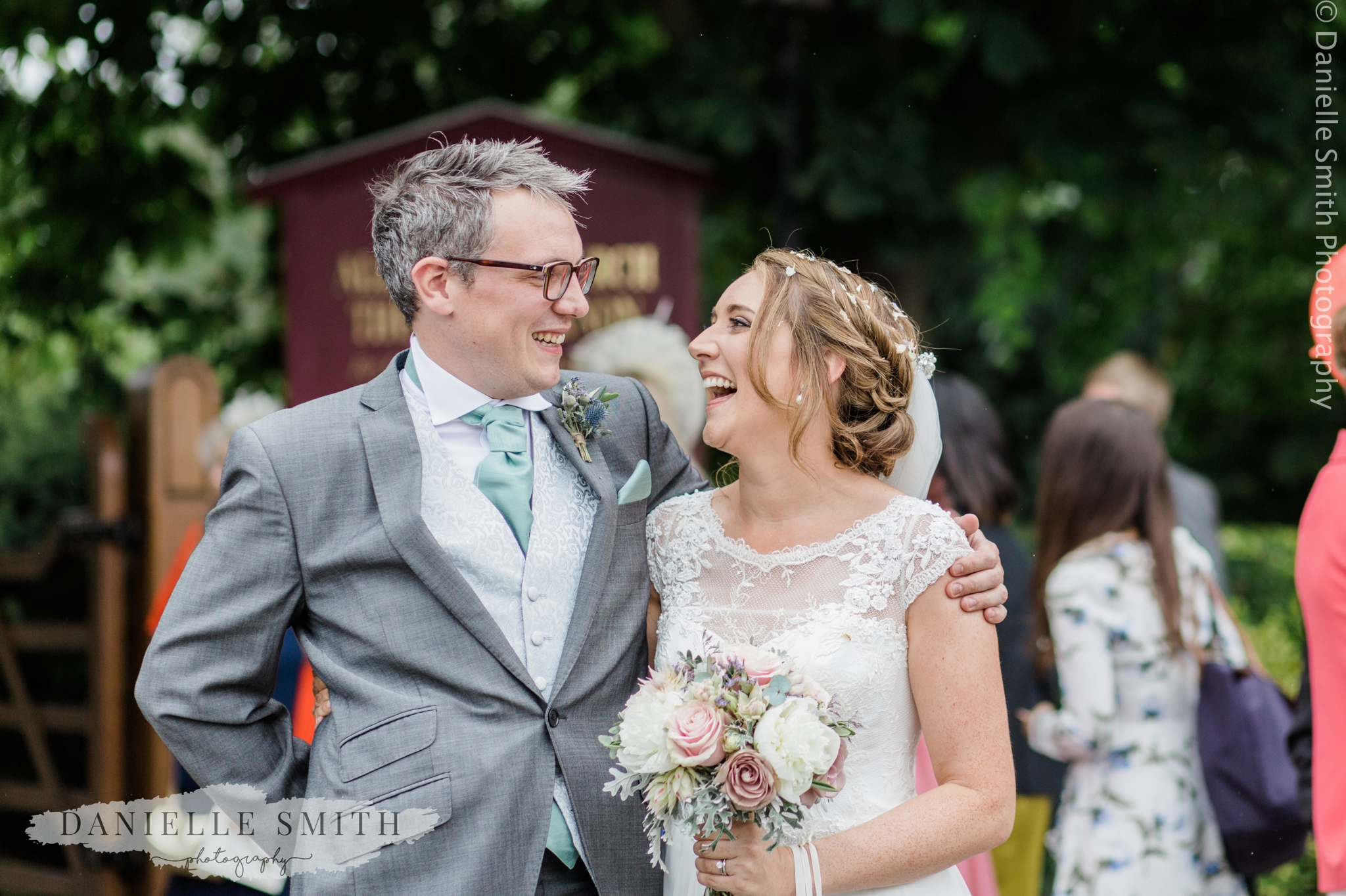 bride and her brother laughing