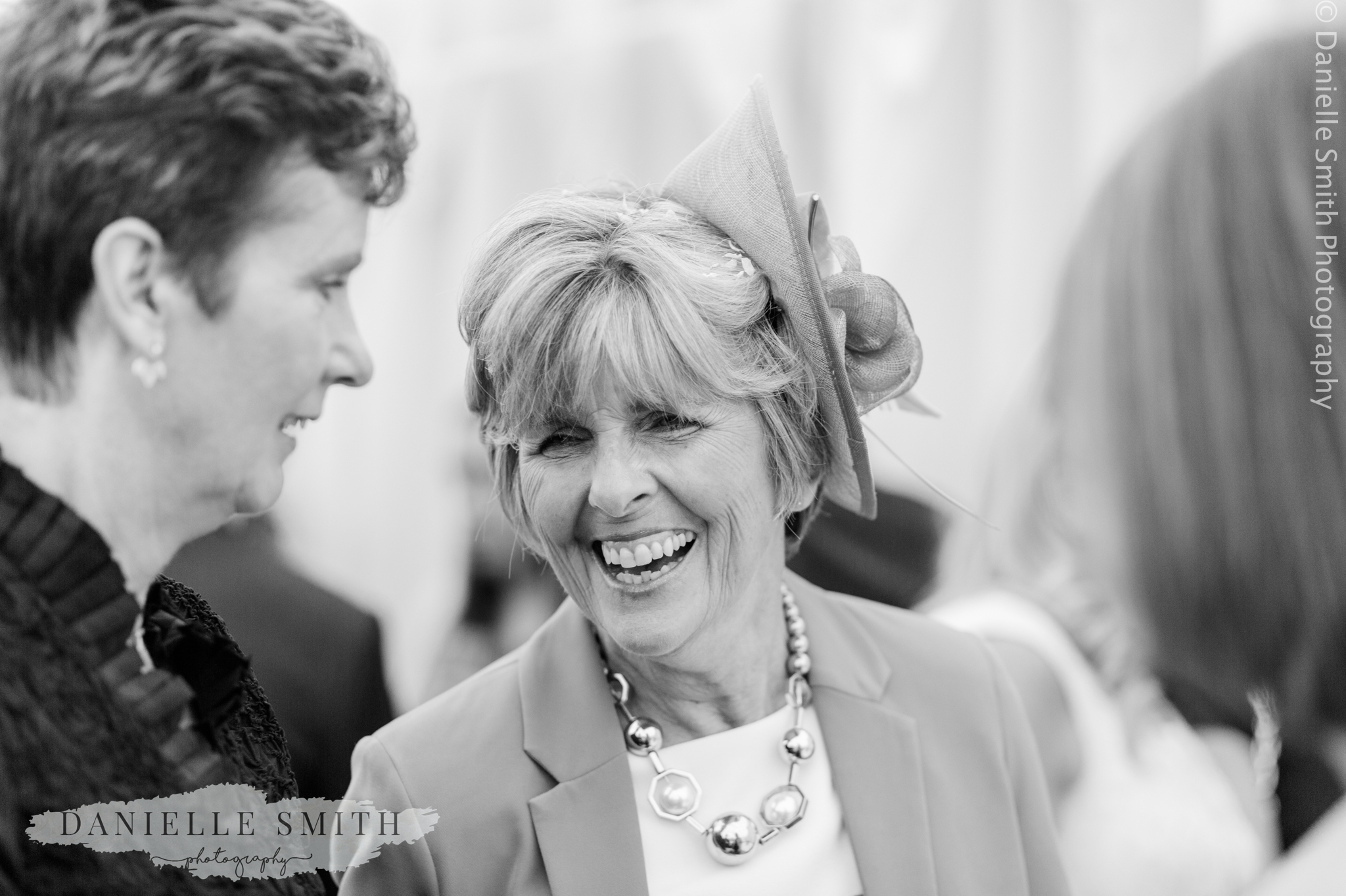 wedding guest laughing - relaxed marquee wedding