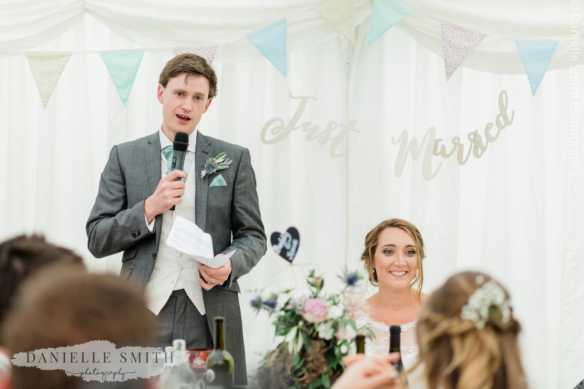 groom giving speech at marquee wedding