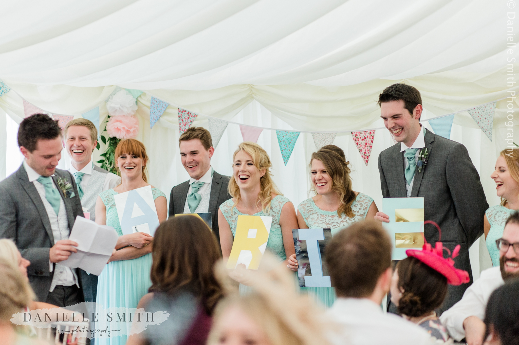 bridal party holding letters