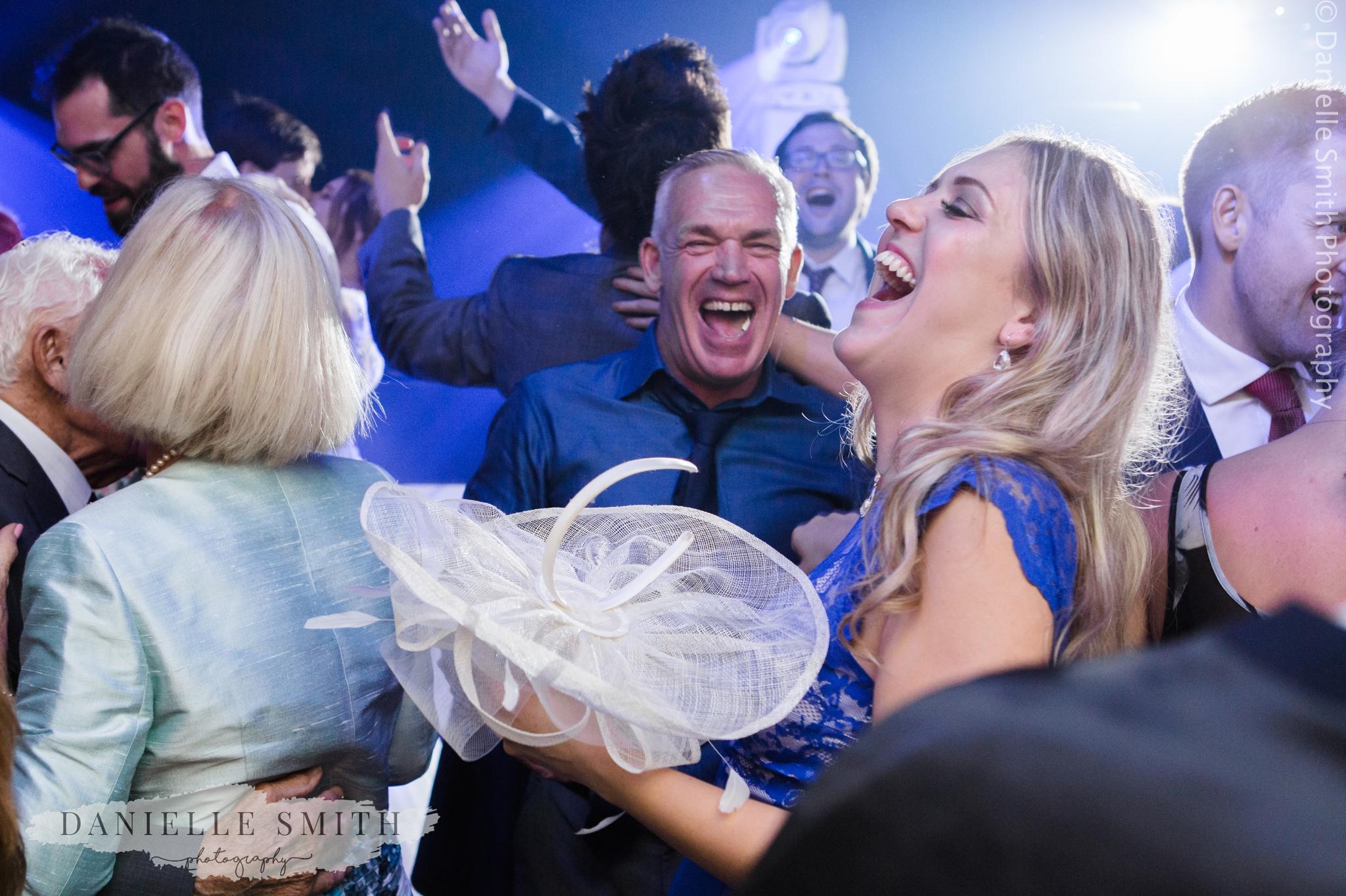 wedding guests having fun on dance floor