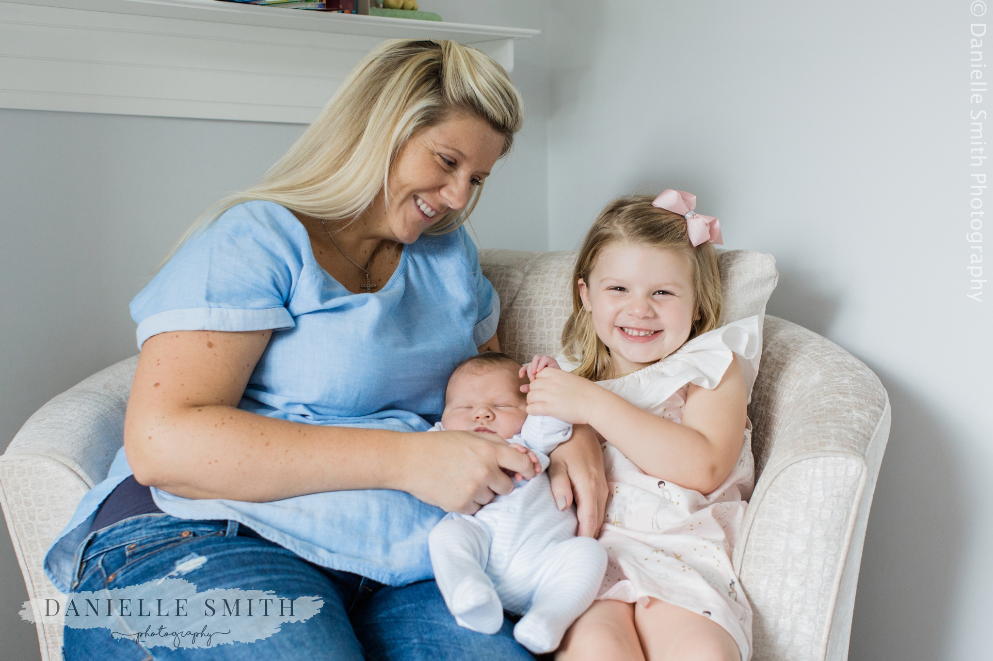mum and 2 children in nursery