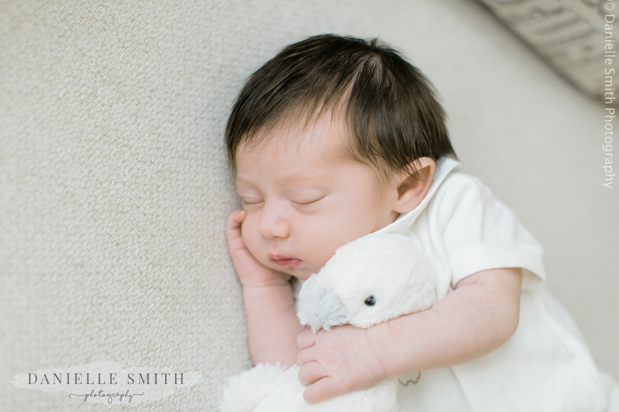 baby cuddling teddy - natural newborn baby photos at home