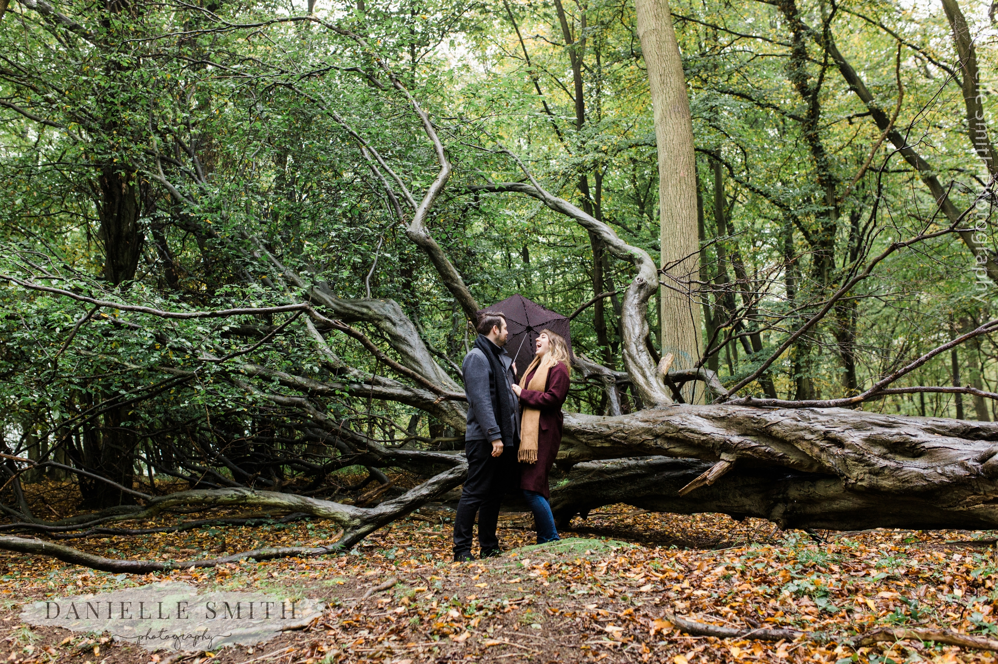 couple laughing in autumn woodland