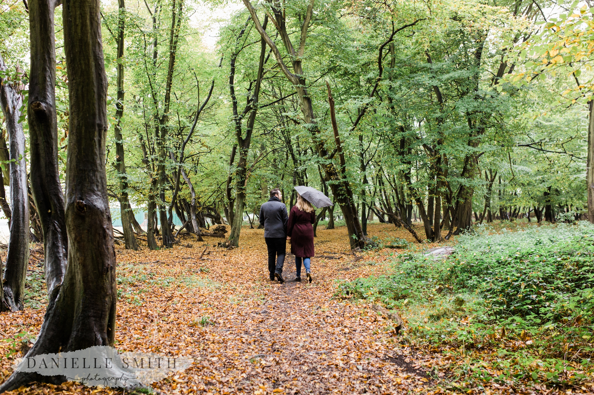couple walking away in woods