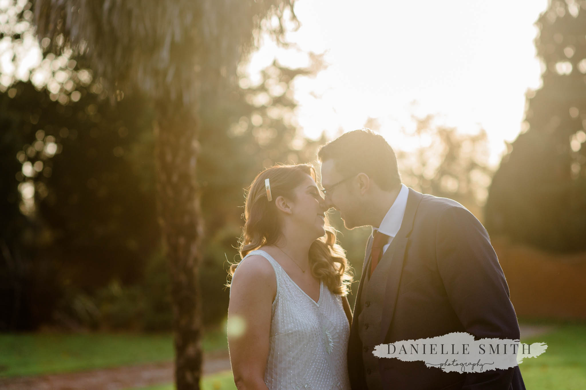 bride and groom at orsett hall during sunset