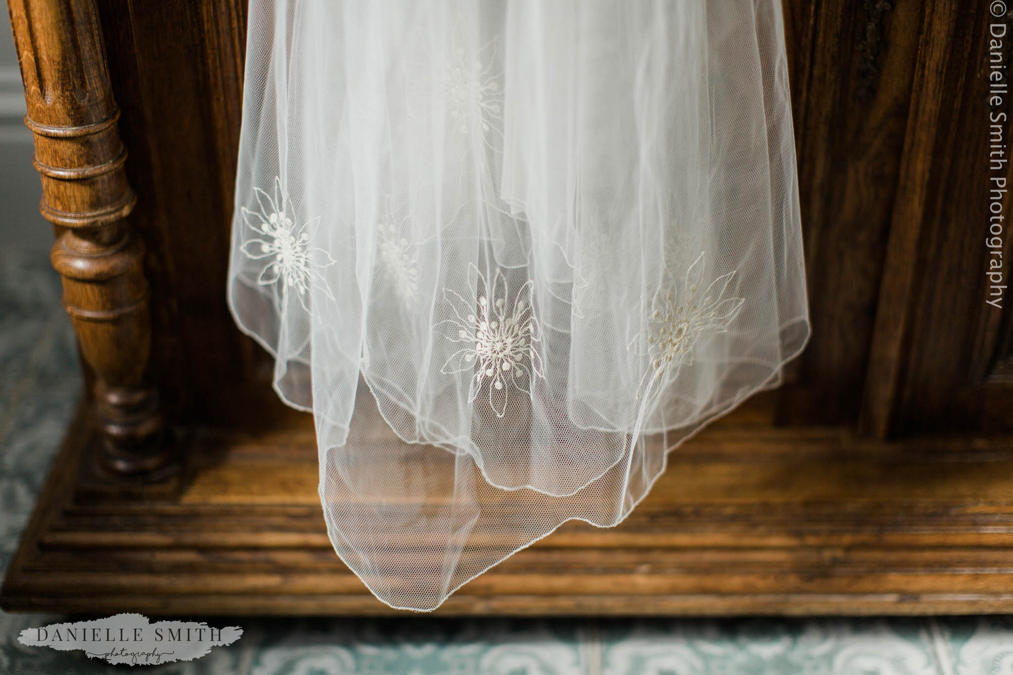 wedding veil hanging on dresser