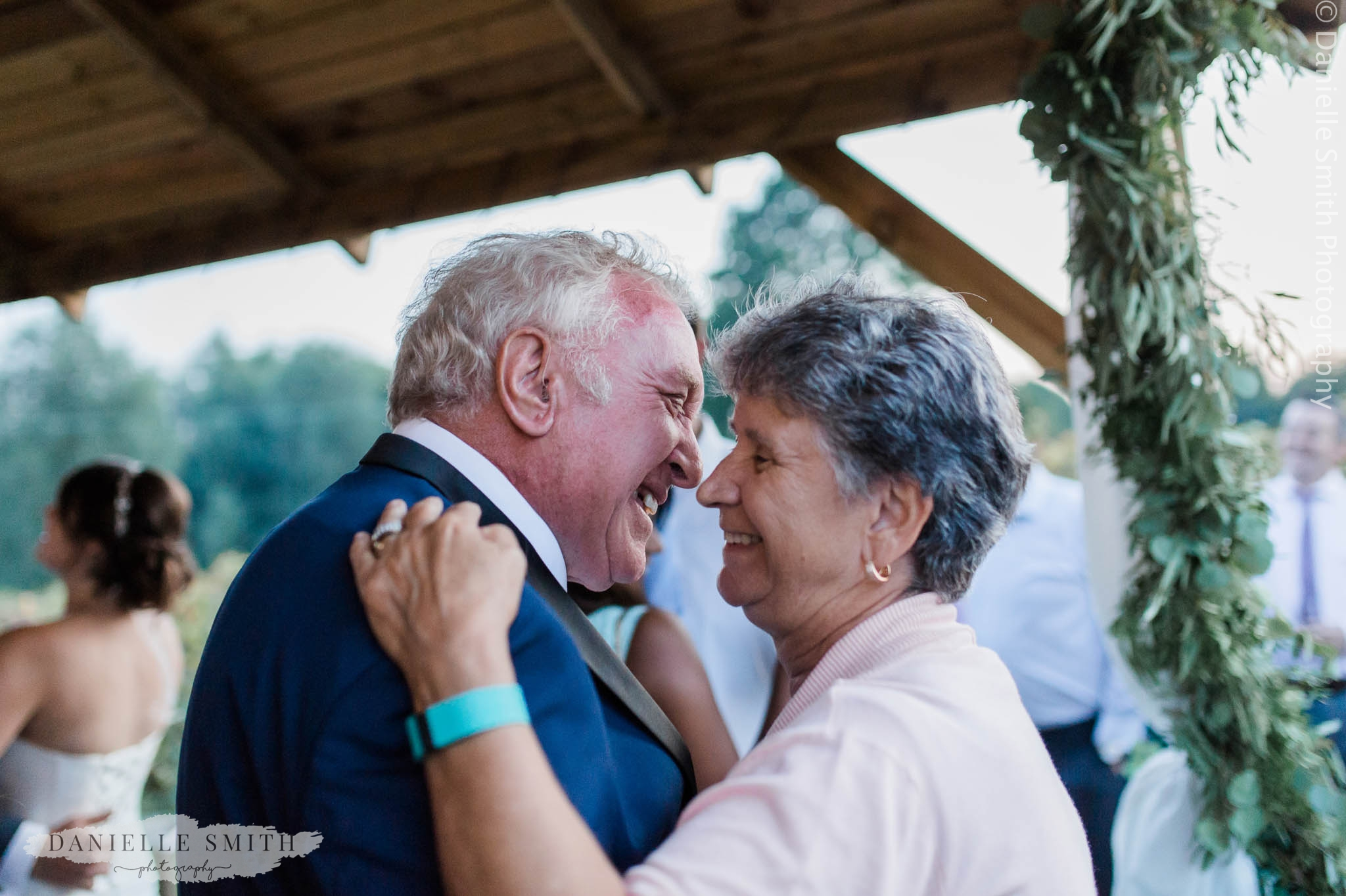 nan and granddad dancing at outdoor wedding