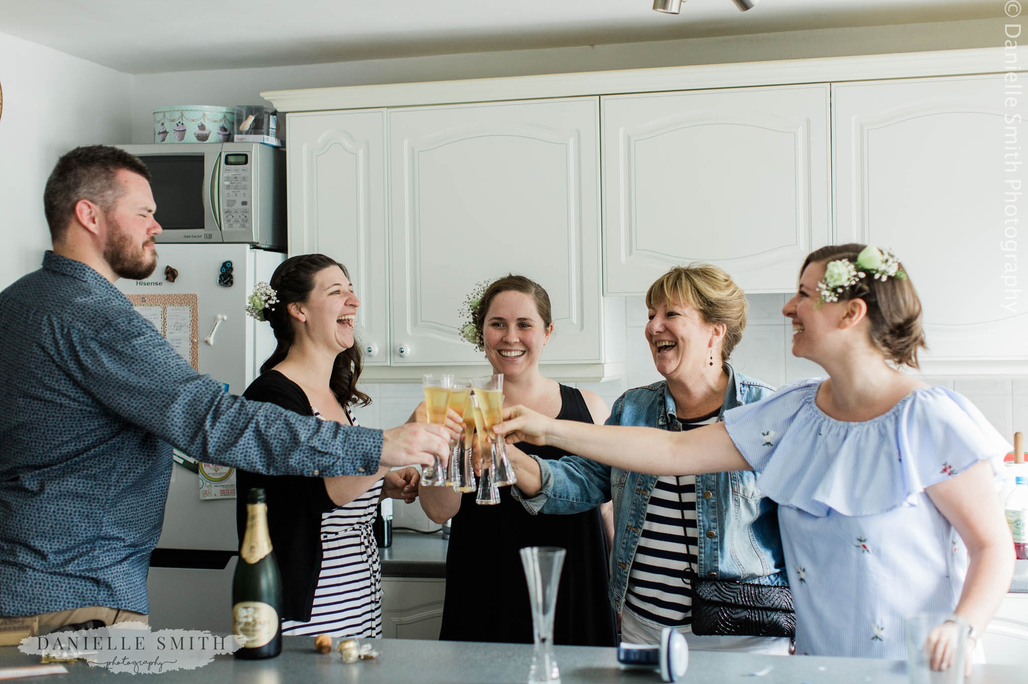bridal party toasting with champagne