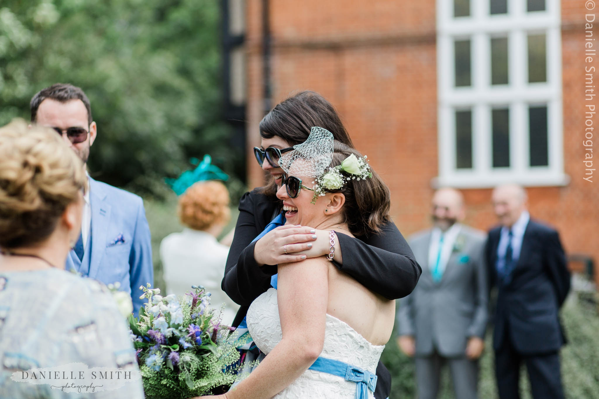 friend hugging the bride - relaxed and fun wedding