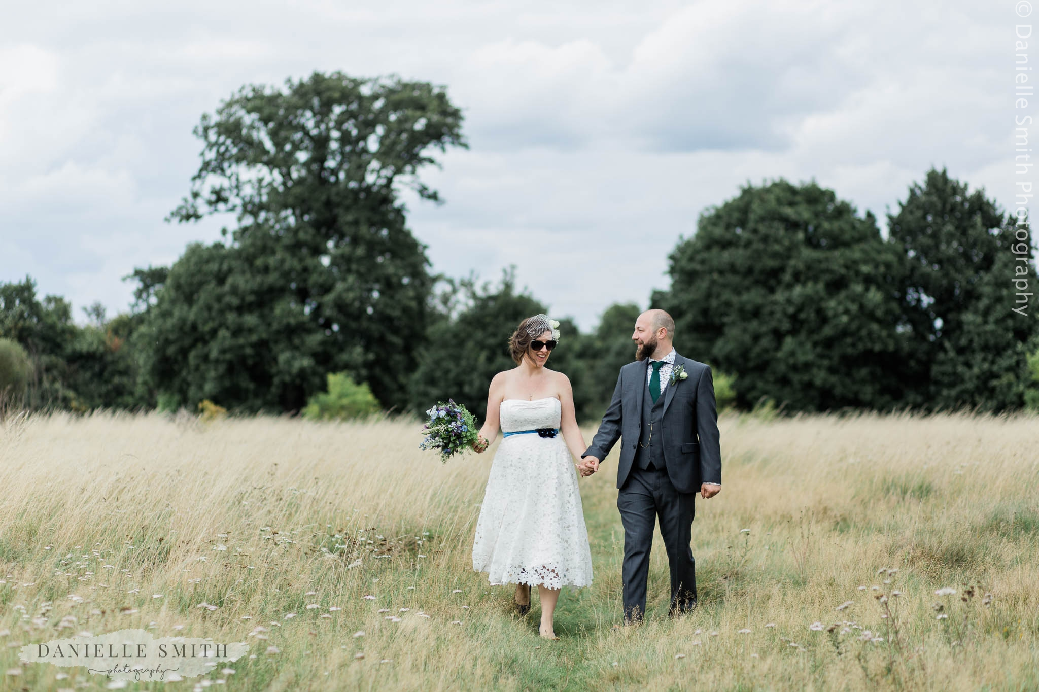bride and groom walking in park - east london wedding