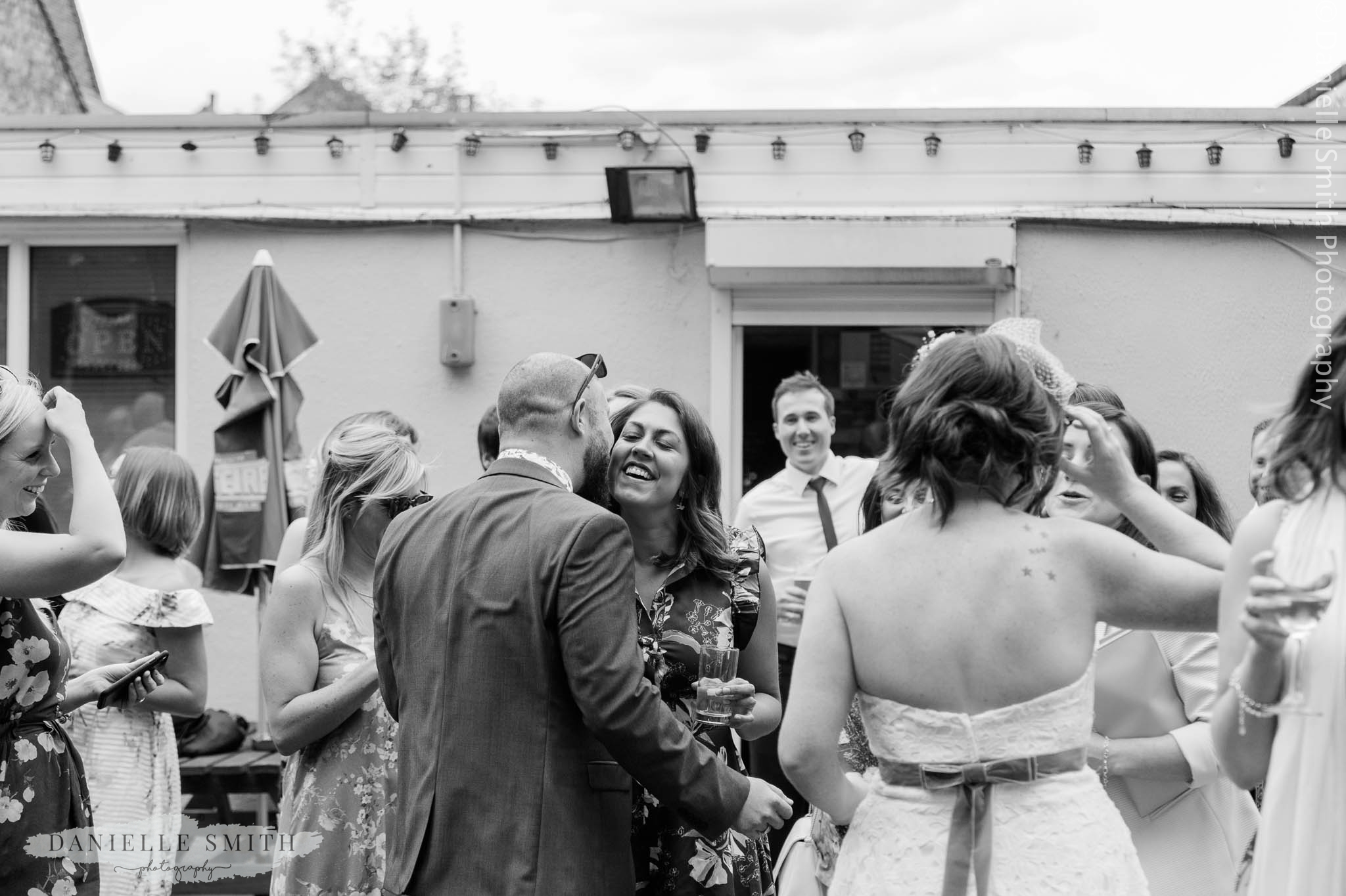 groom kissing guest on cheek