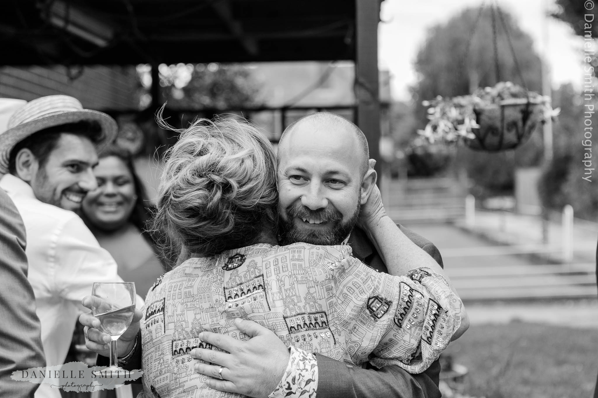 groom hugging new mother in law - bowls club wedding