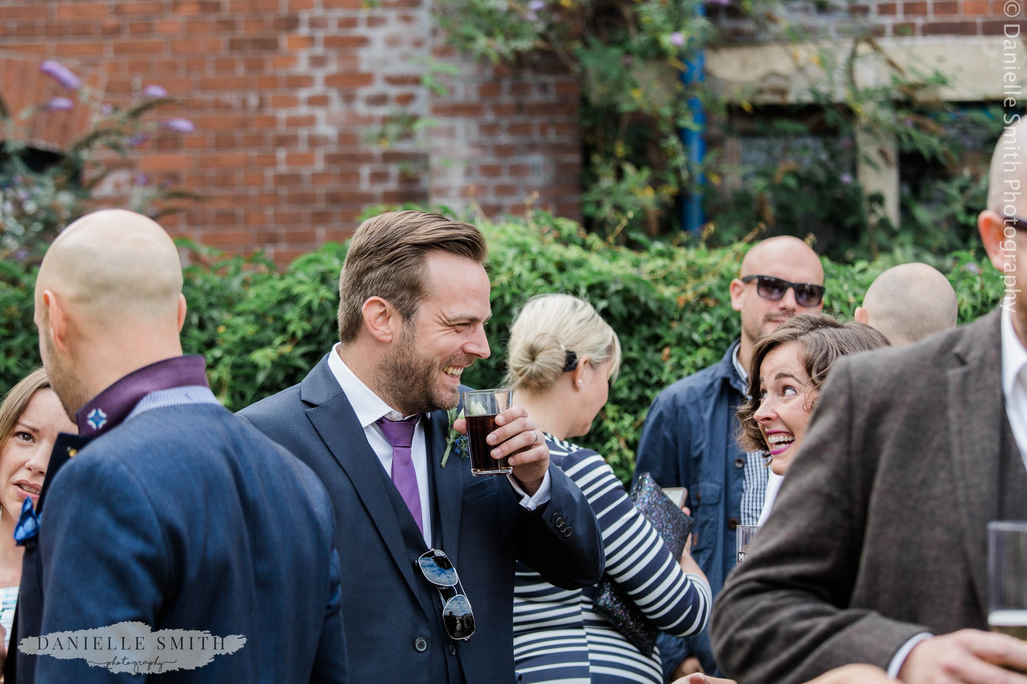wedding guests laughing - east london wedding
