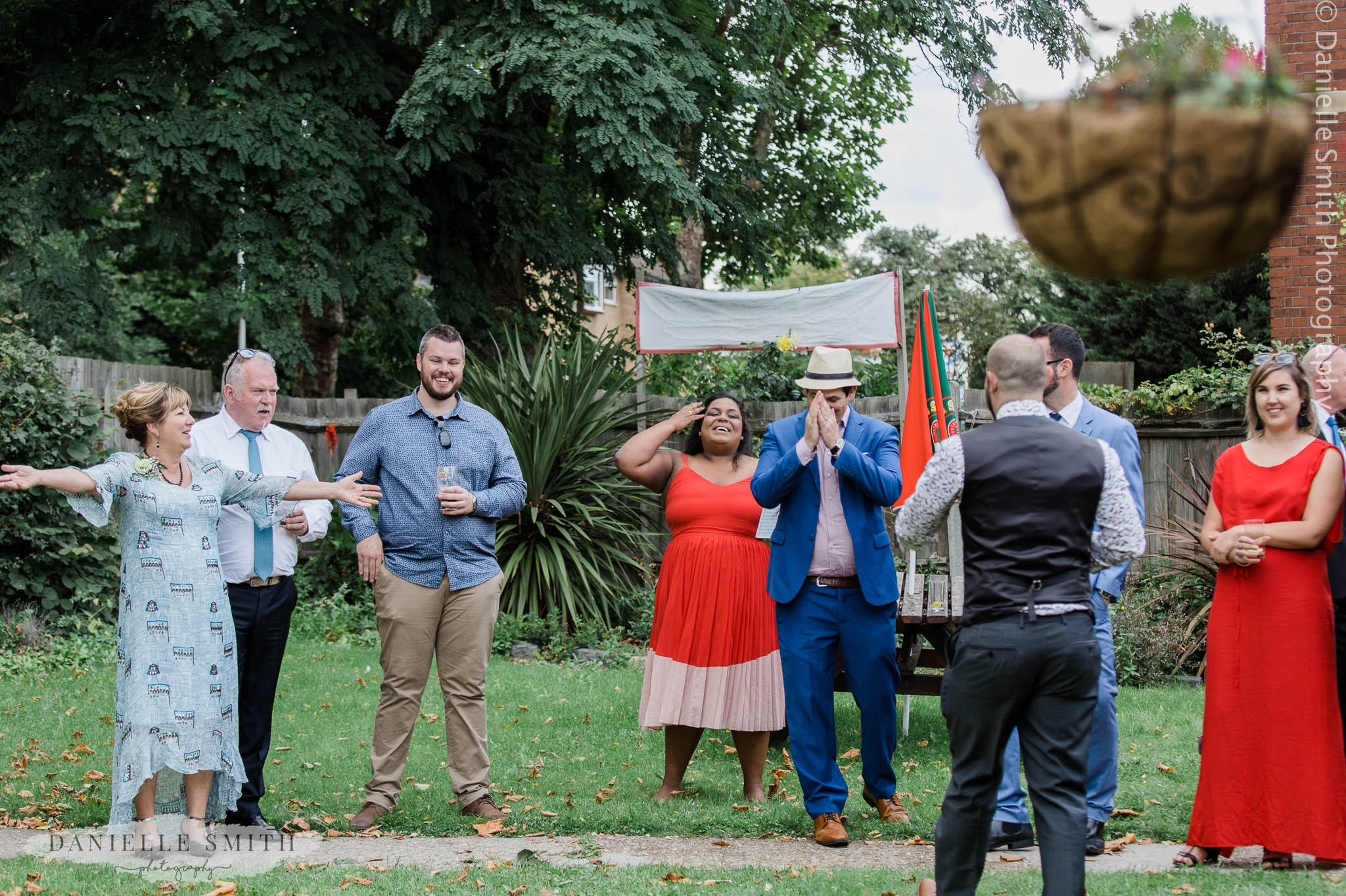 wedding guests playing garden games - relaxed and fun wedding