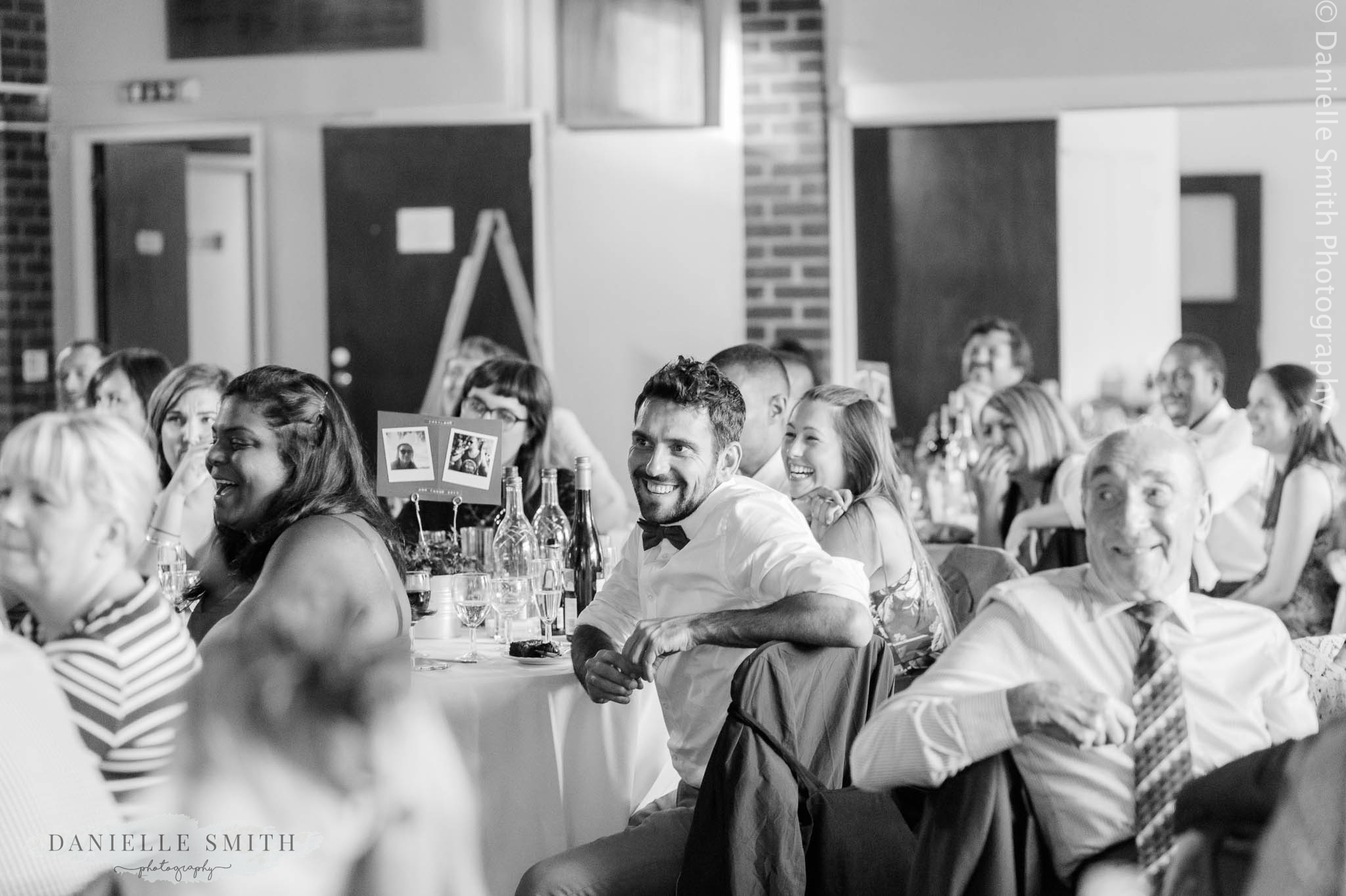wedding guests smiling during speeches - bowls club wedding
