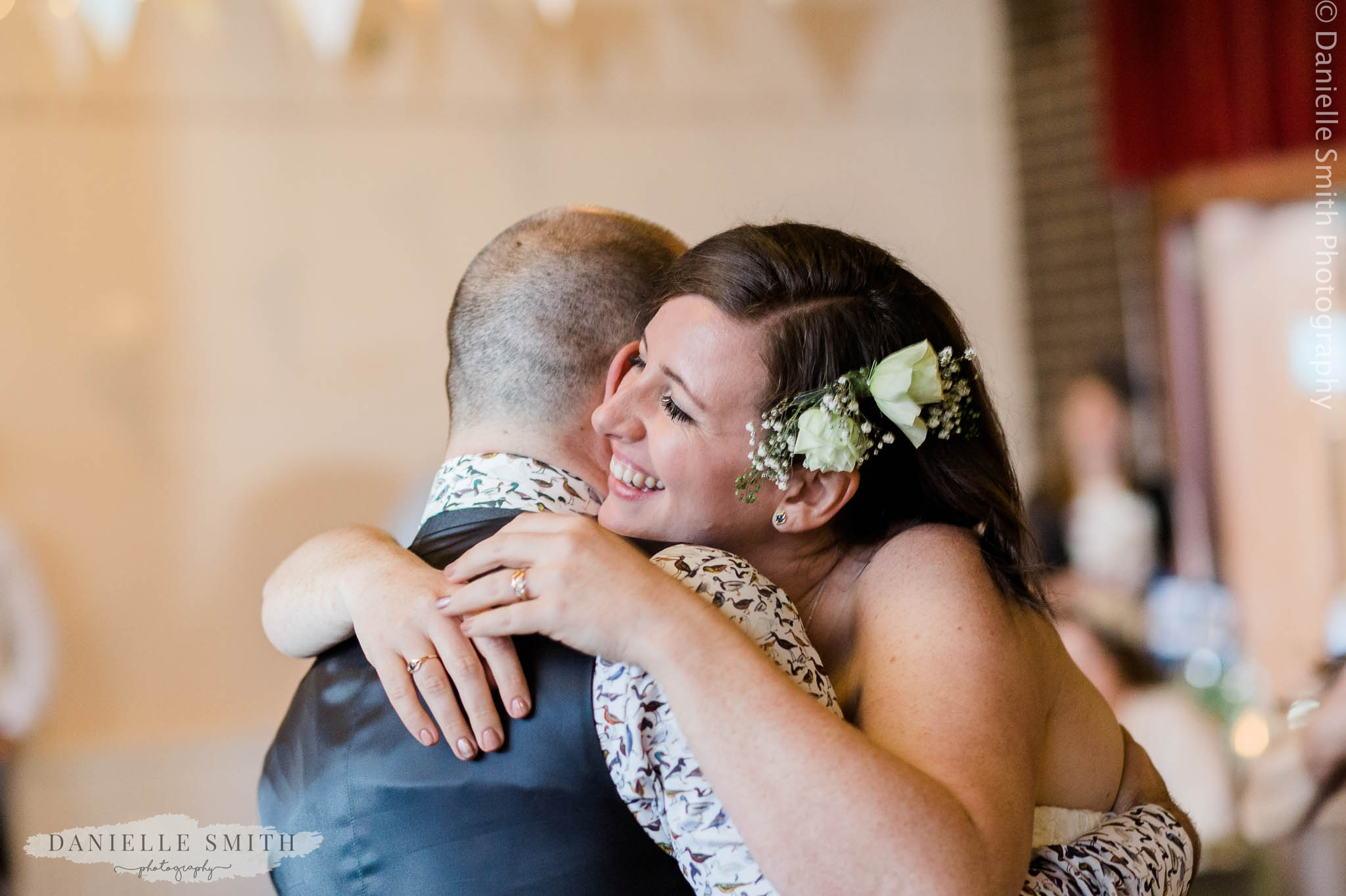 bride hugging groom - east london wedding