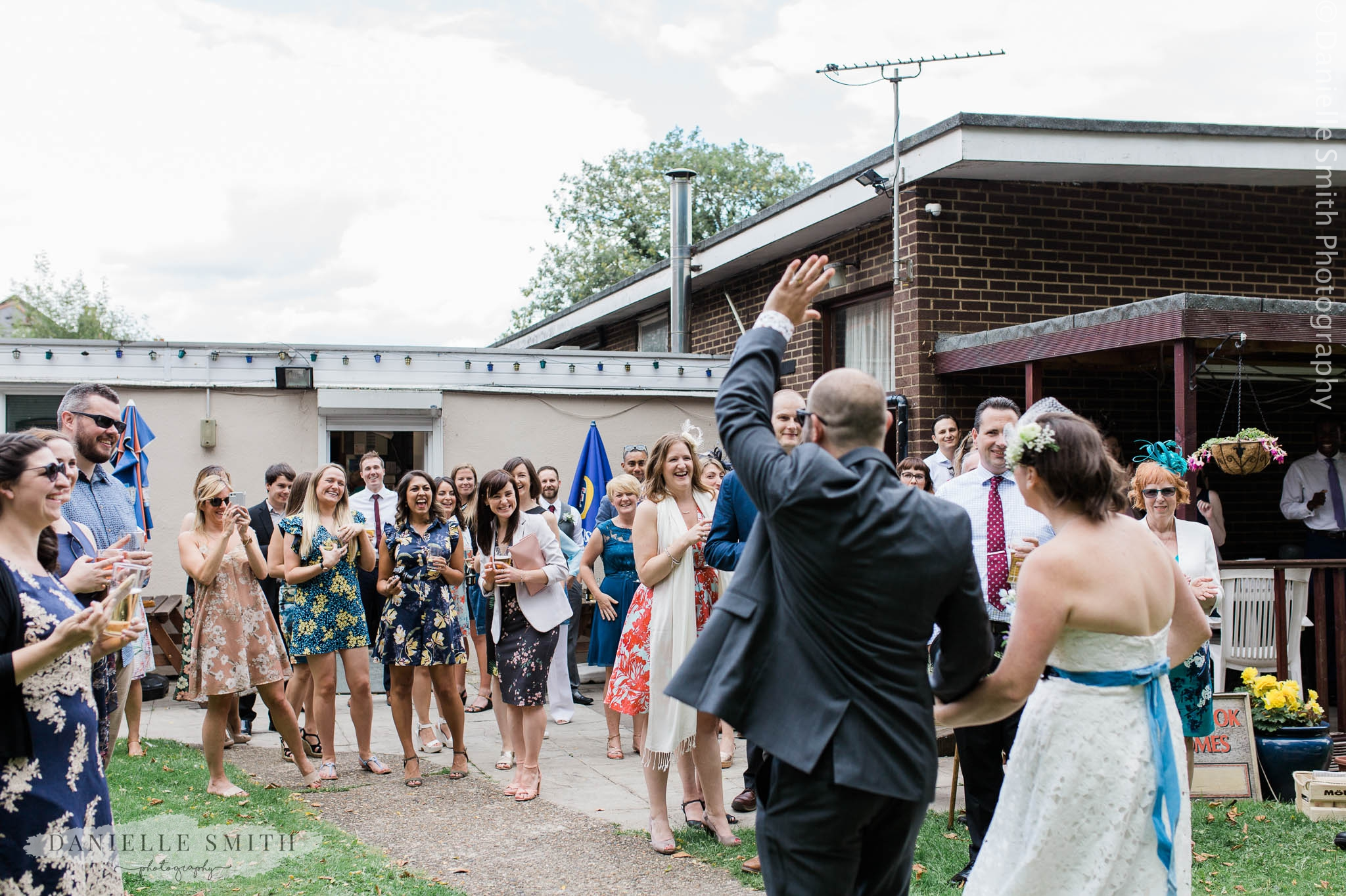 wedding guests cheering bride and groom - east london wedding