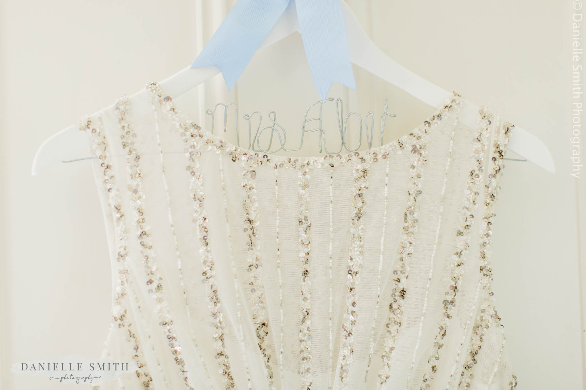 personalised bridal hanger with wedding dress