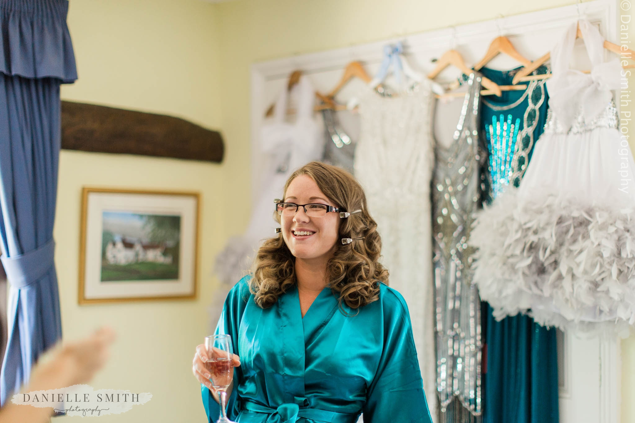 bridesmaid in teal gown laughing