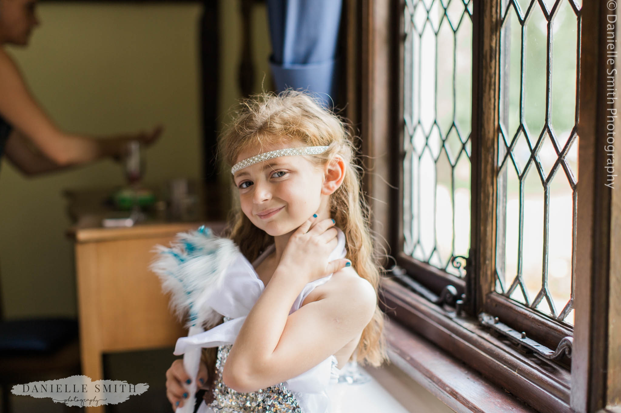 flower girl with feather bouquet - gatsby wedding