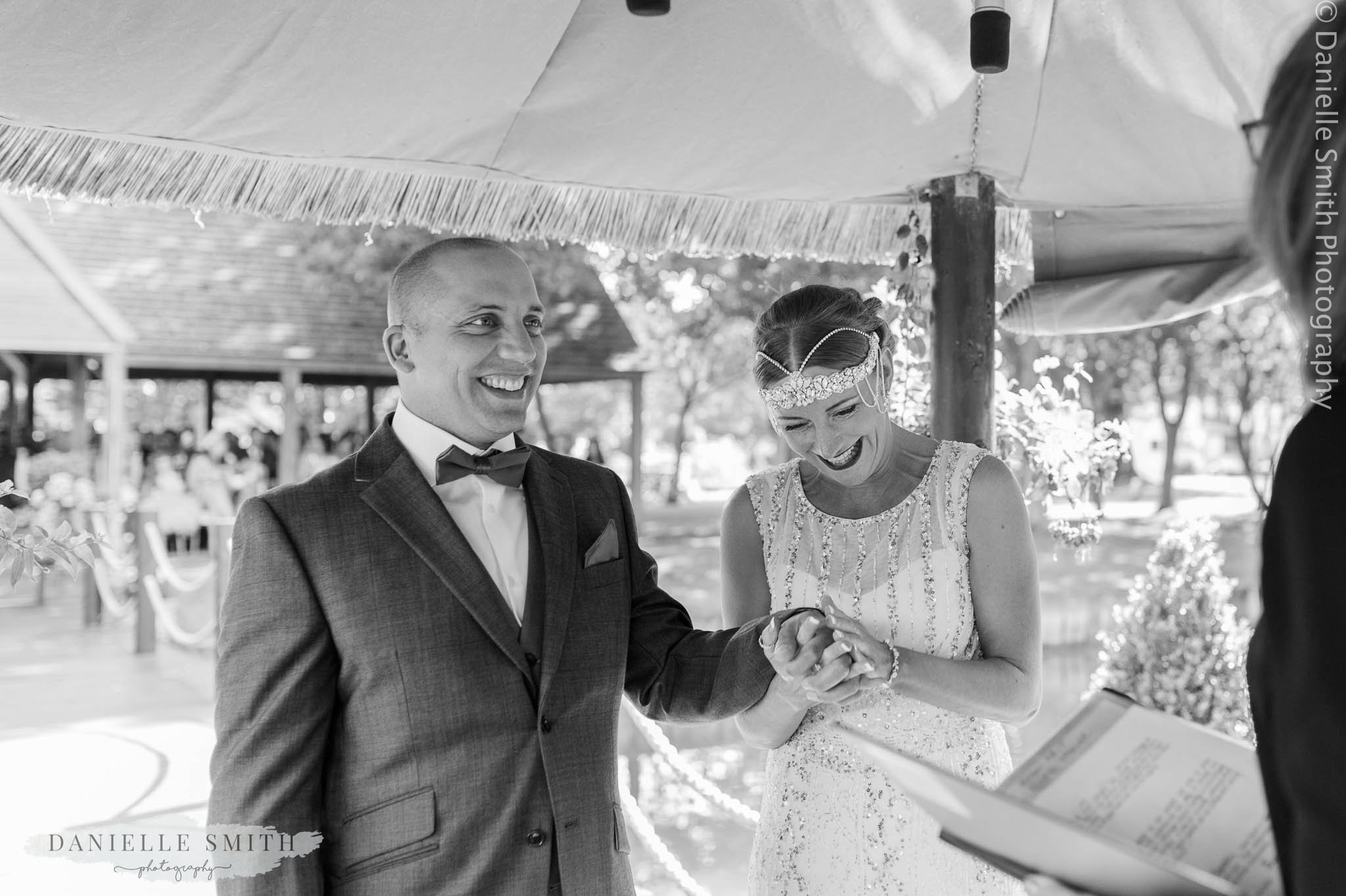 bride and groom laughing during vows - mangapp manor wedding