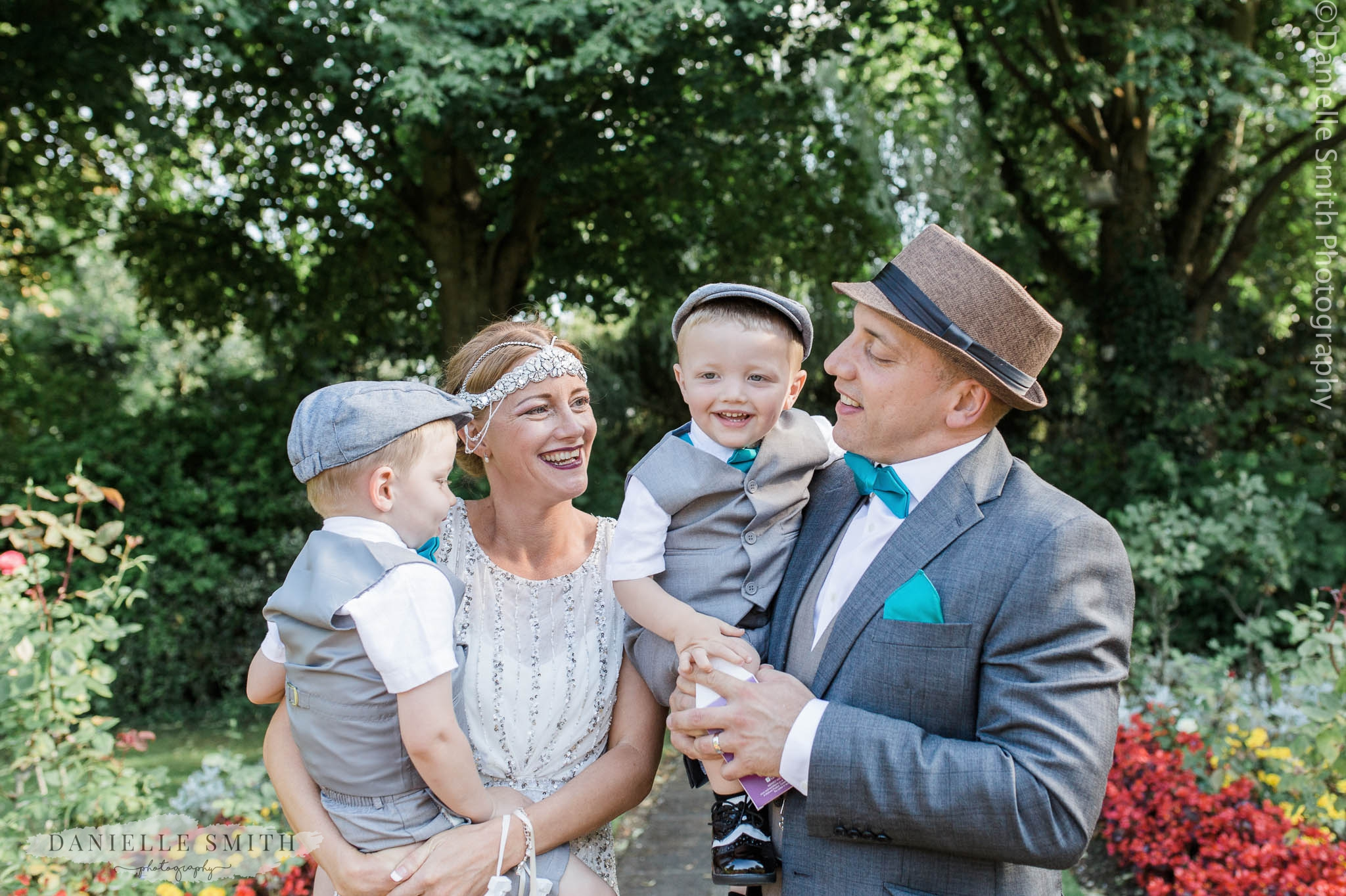 bride, groom and 2 sons at gatsby wedding