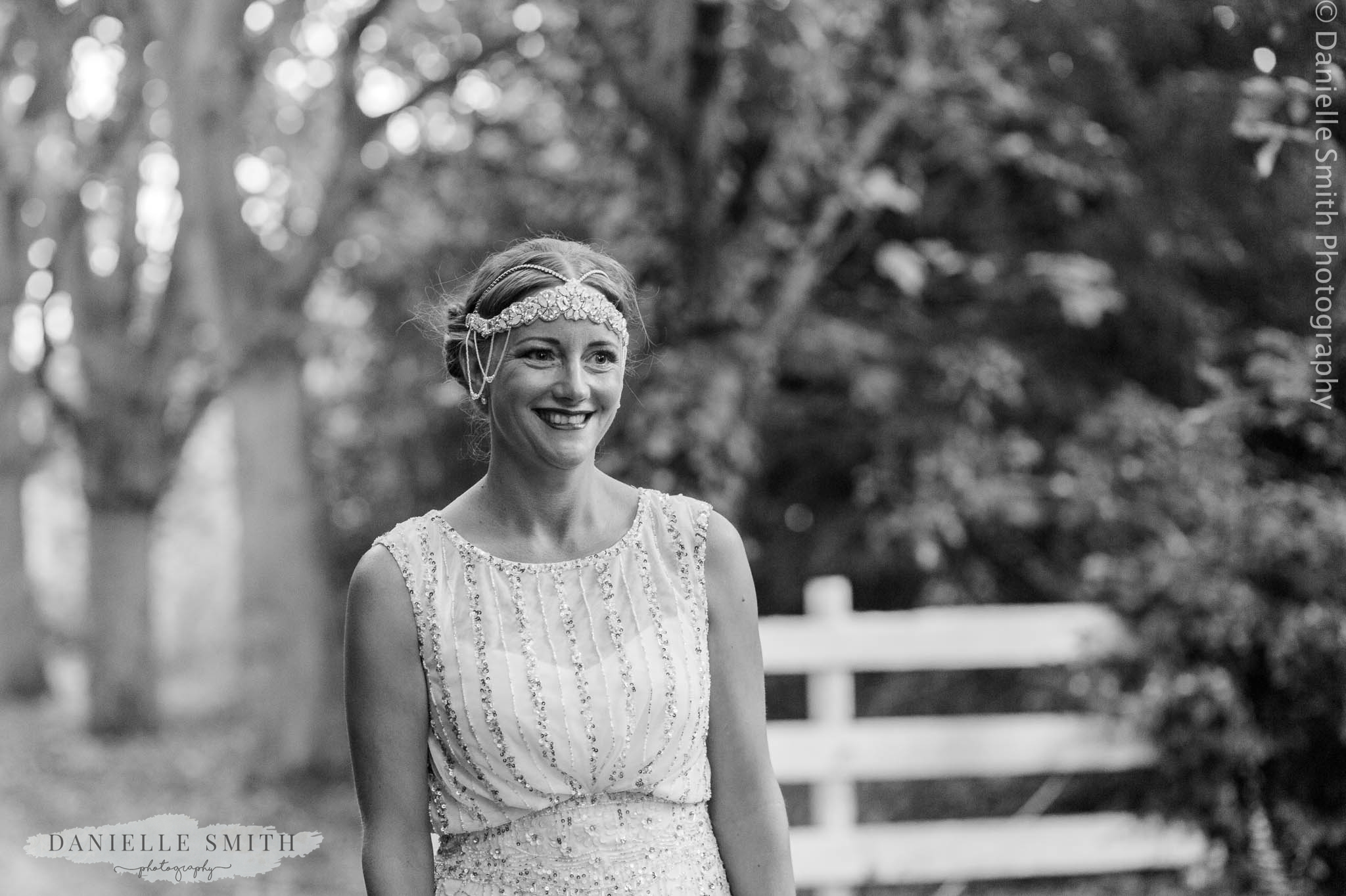 bride with gatsby style head piece