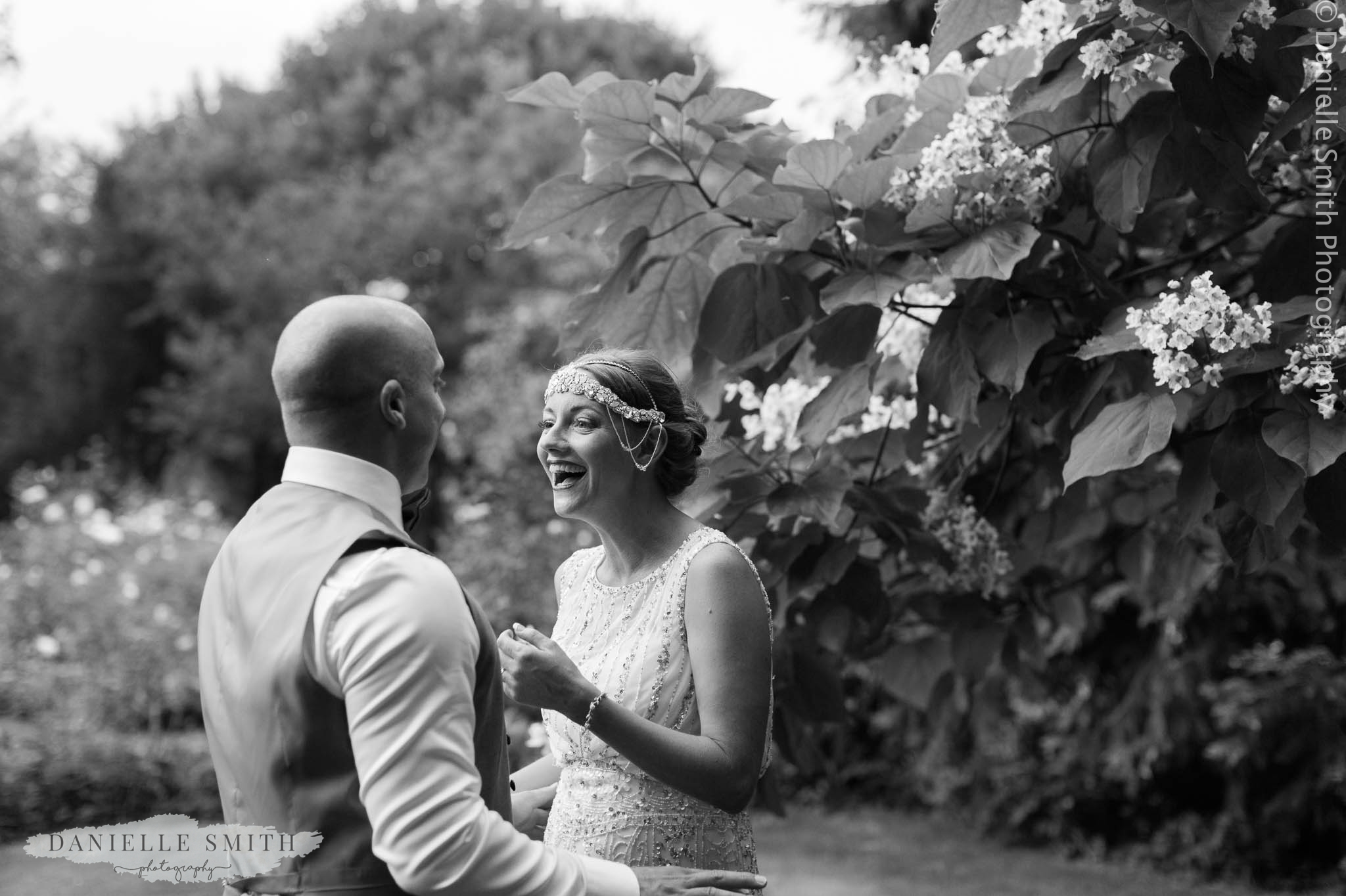 bride laughing at groom - gatsby style wedding