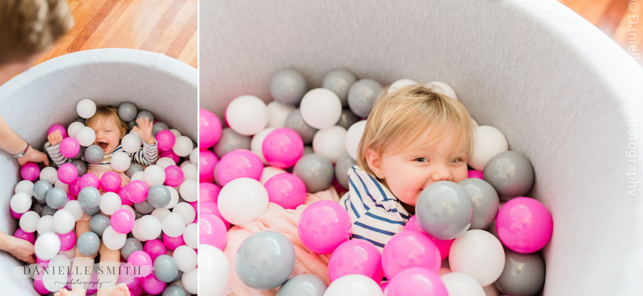 little girl having fun on her first birthday photo shoot