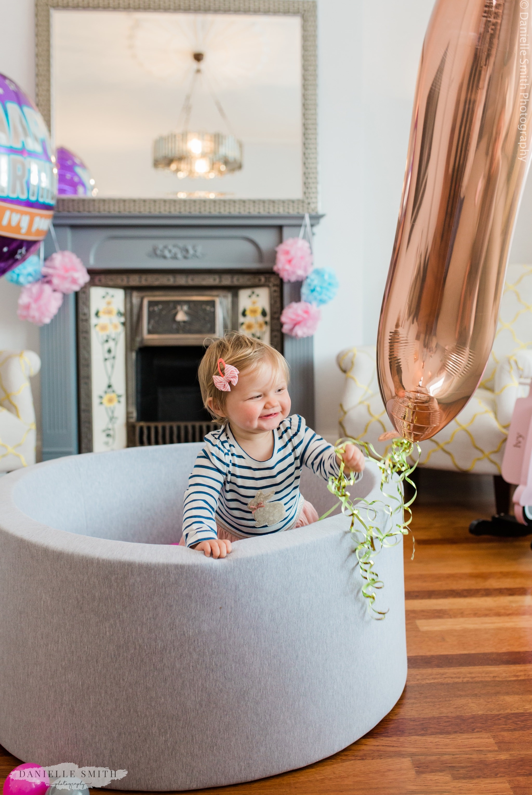 girl with first birthday balloon