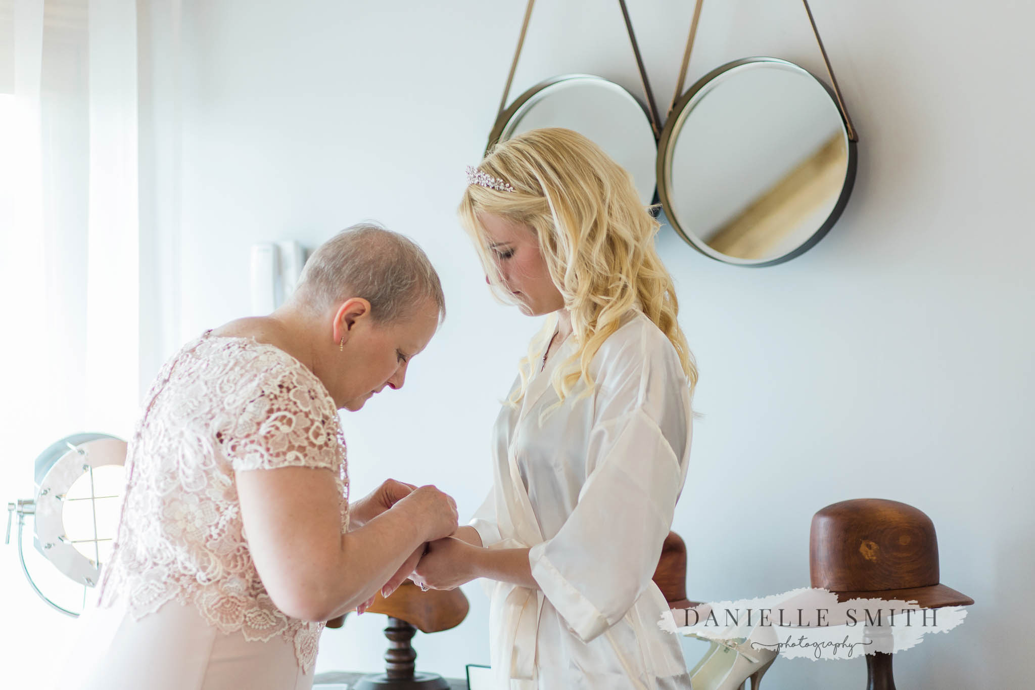 mother of the bride helping her get ready at cooling castle kent