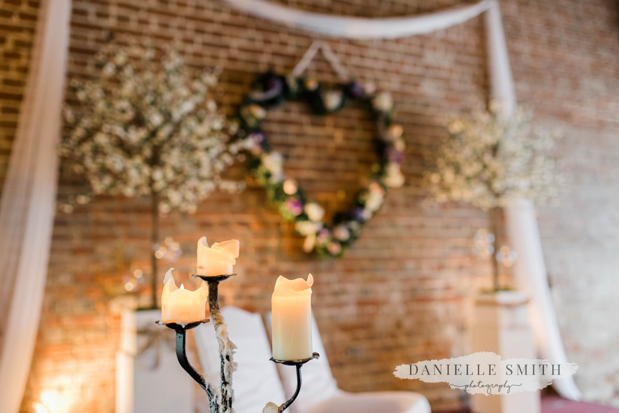candles in the ceremony barn at cooling castle