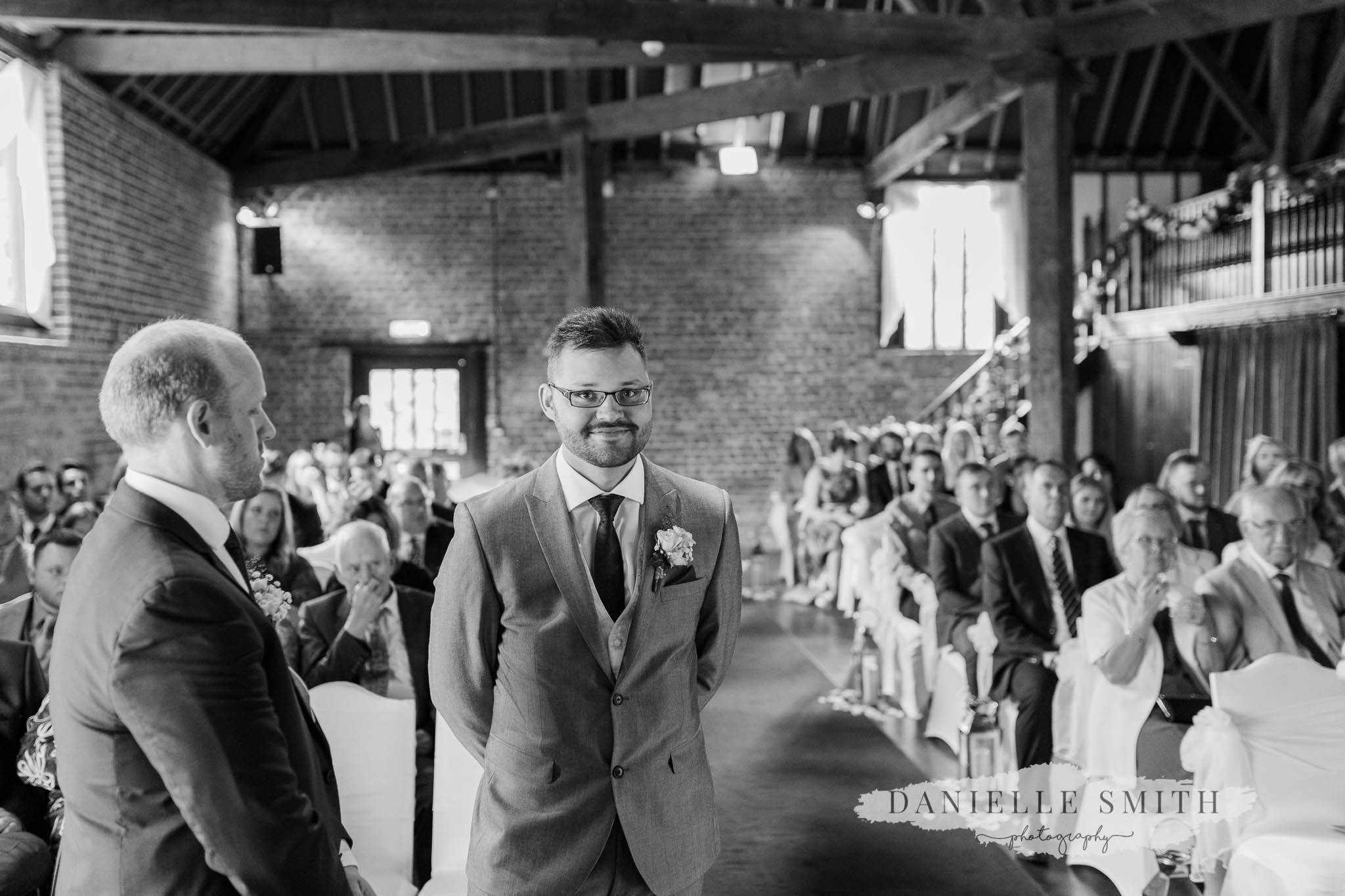 groom waiting for his bride - cooling castle wedding photography