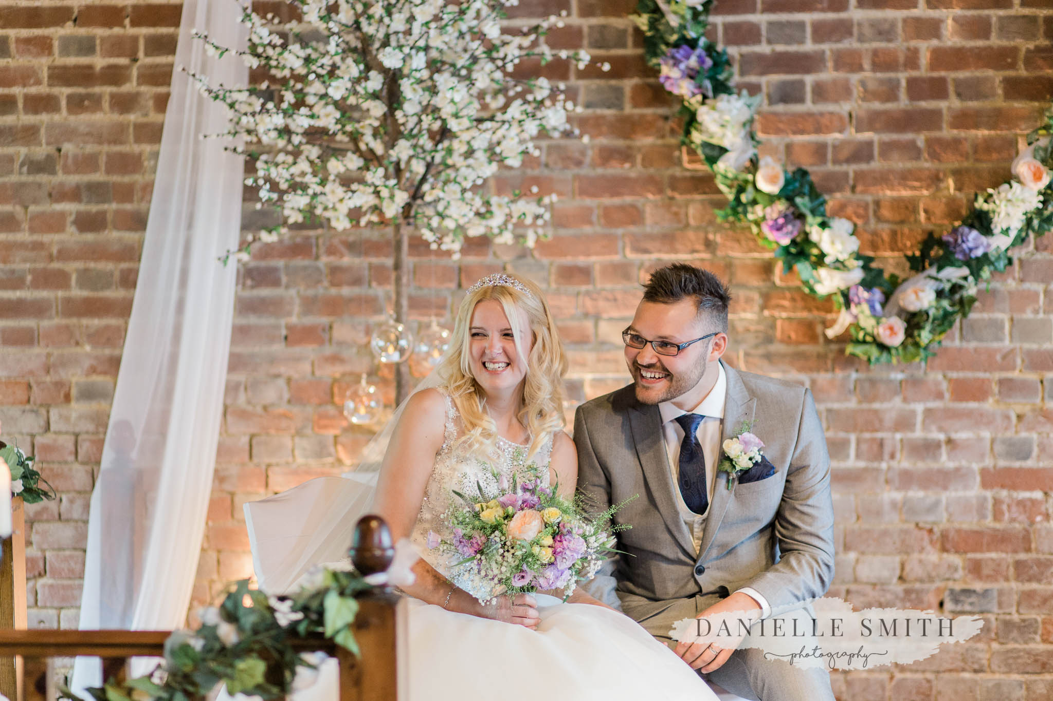 bride and groom laughing at cooling castle barn