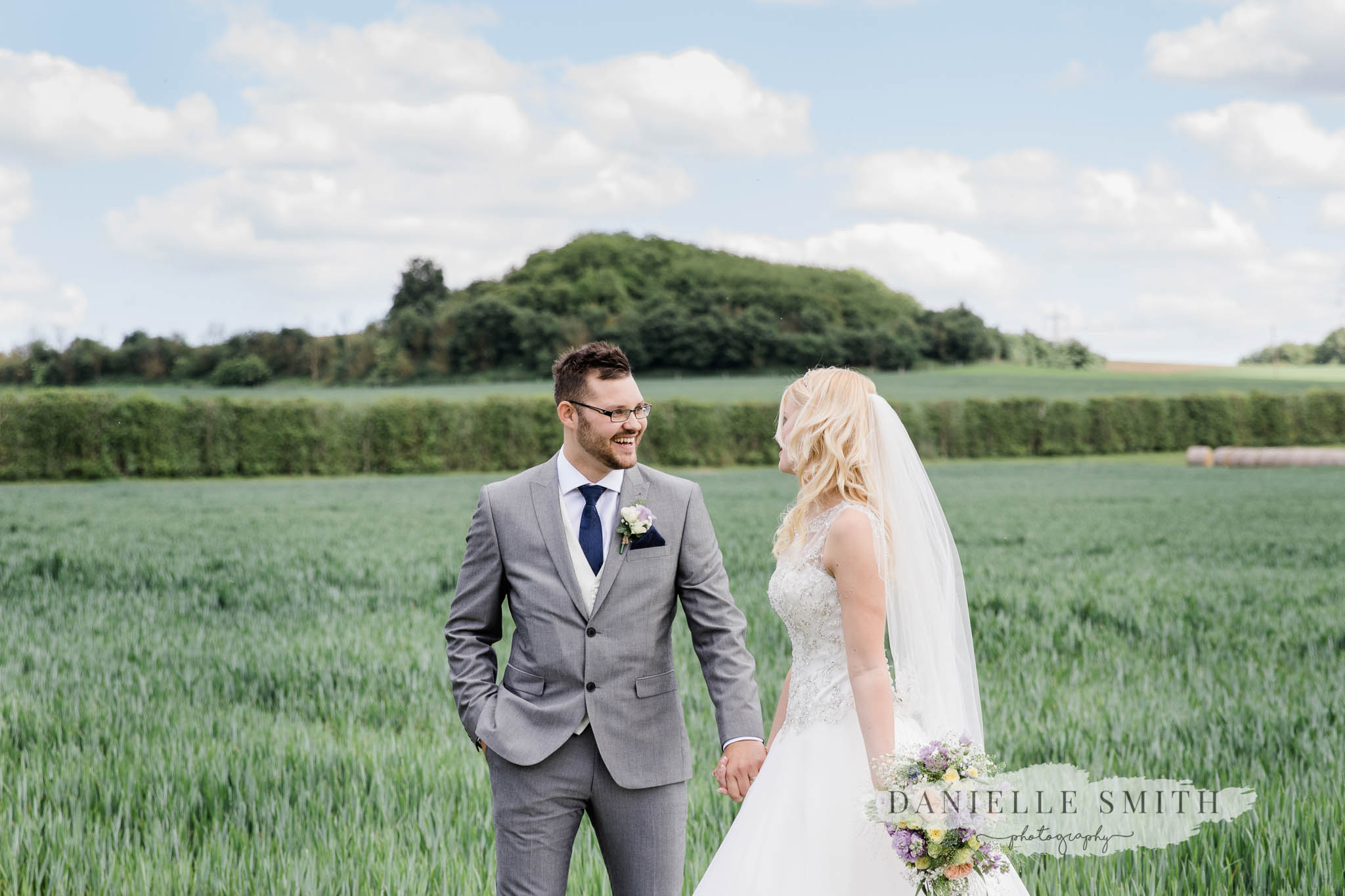 bride and groom in field at cooling castle- wedding photographer kent