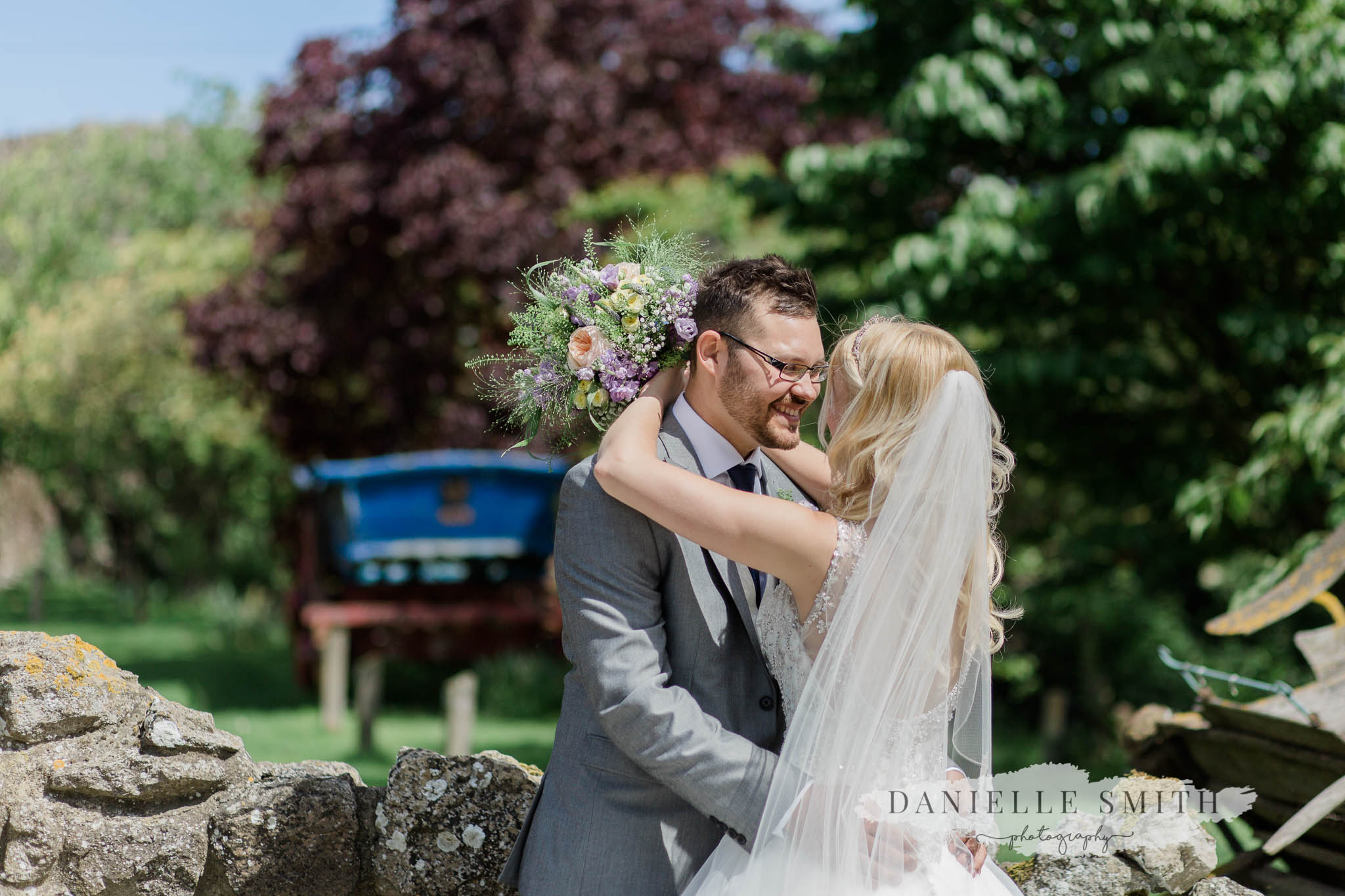 bride and groom kissing outside in gardens