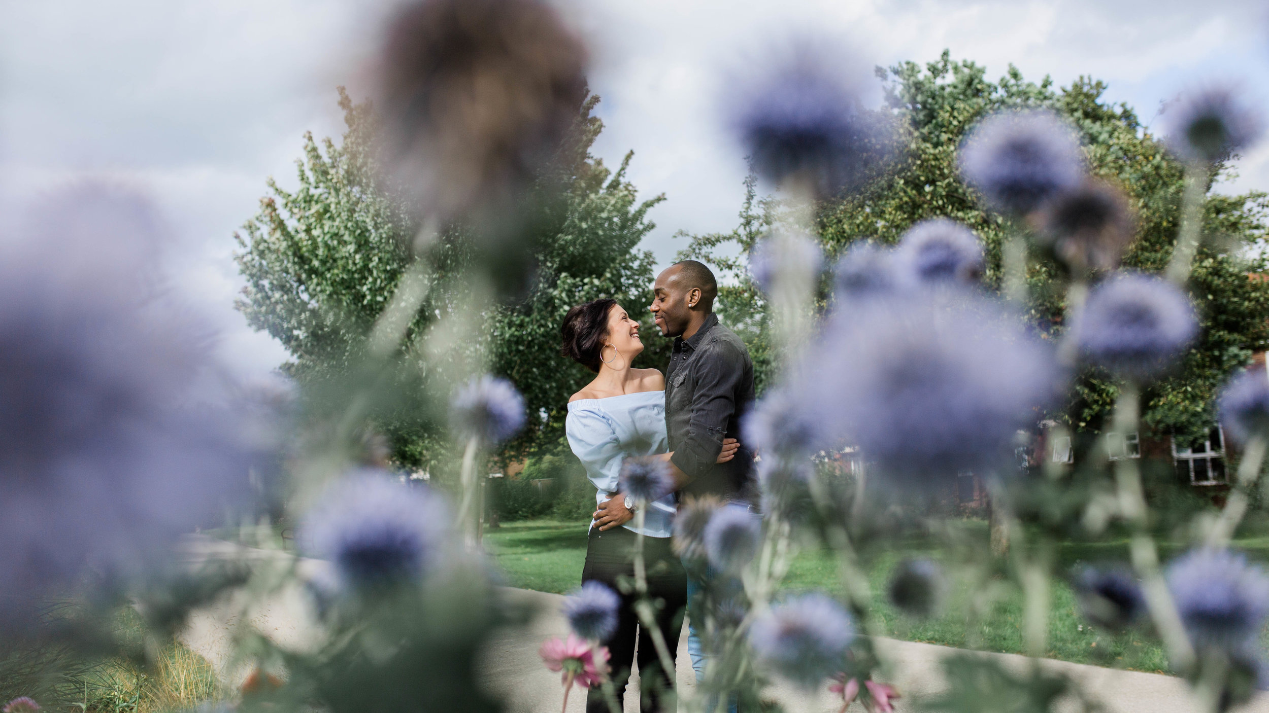 couple in park through flowers