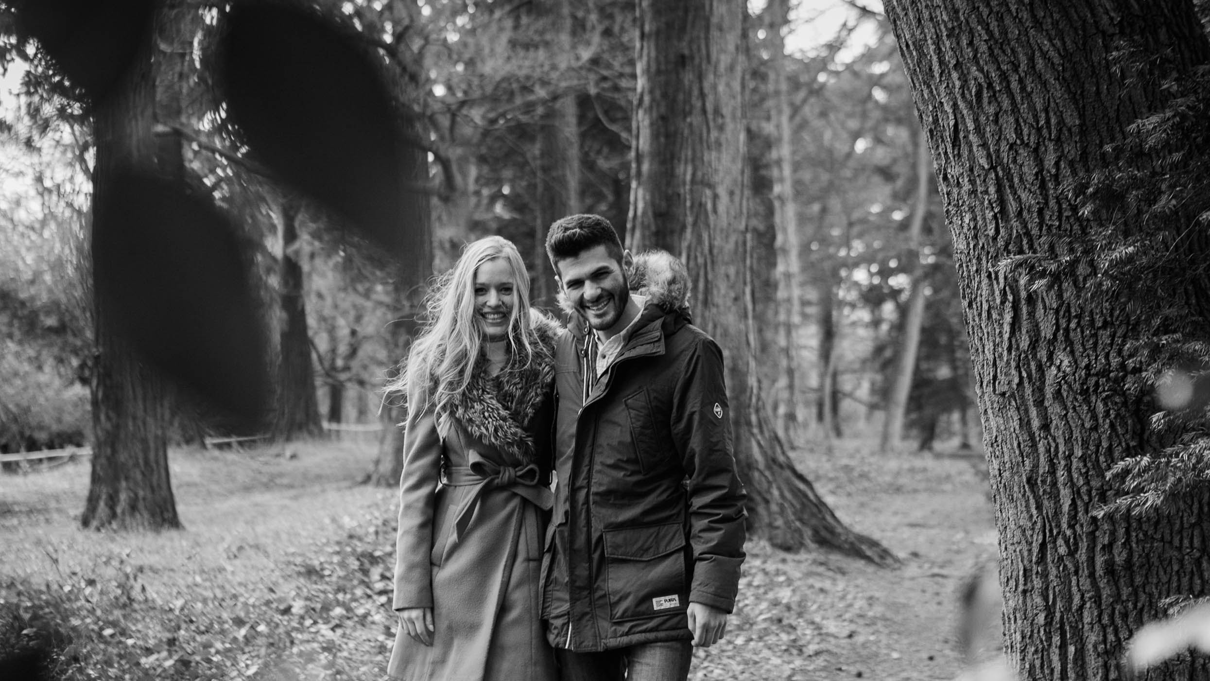 couple standing in woods - pre-wedding photographer