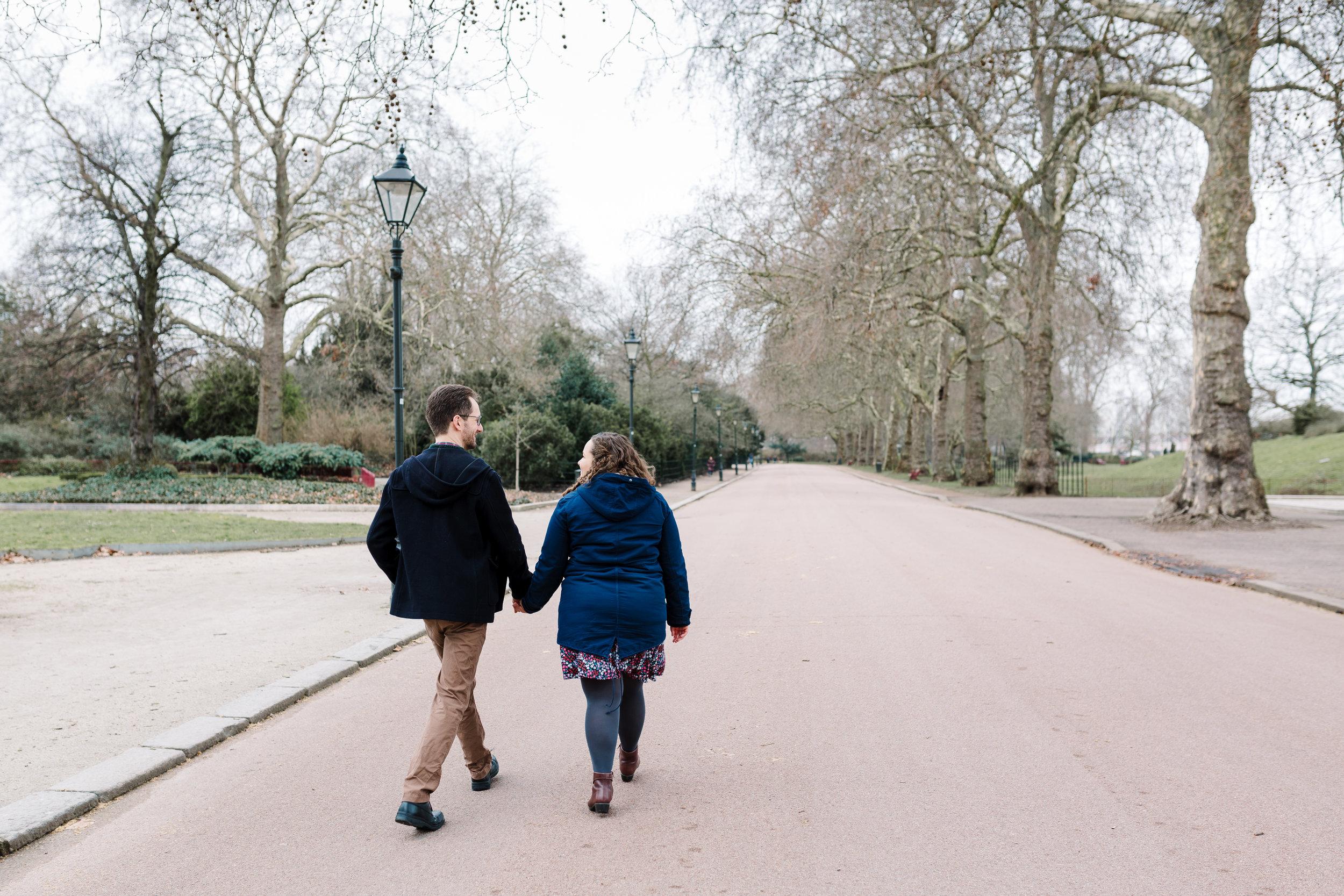 couple walking in london park
