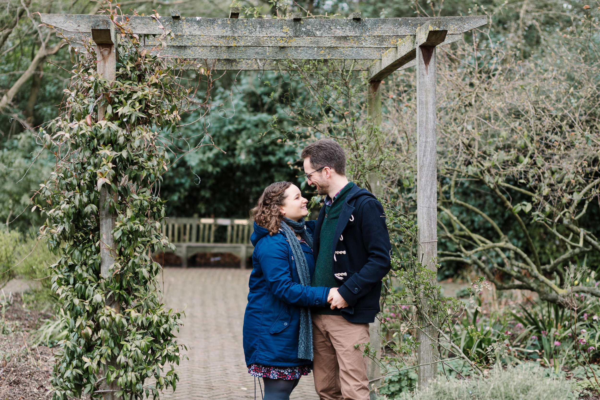 couple standing under pergola in battersea park
