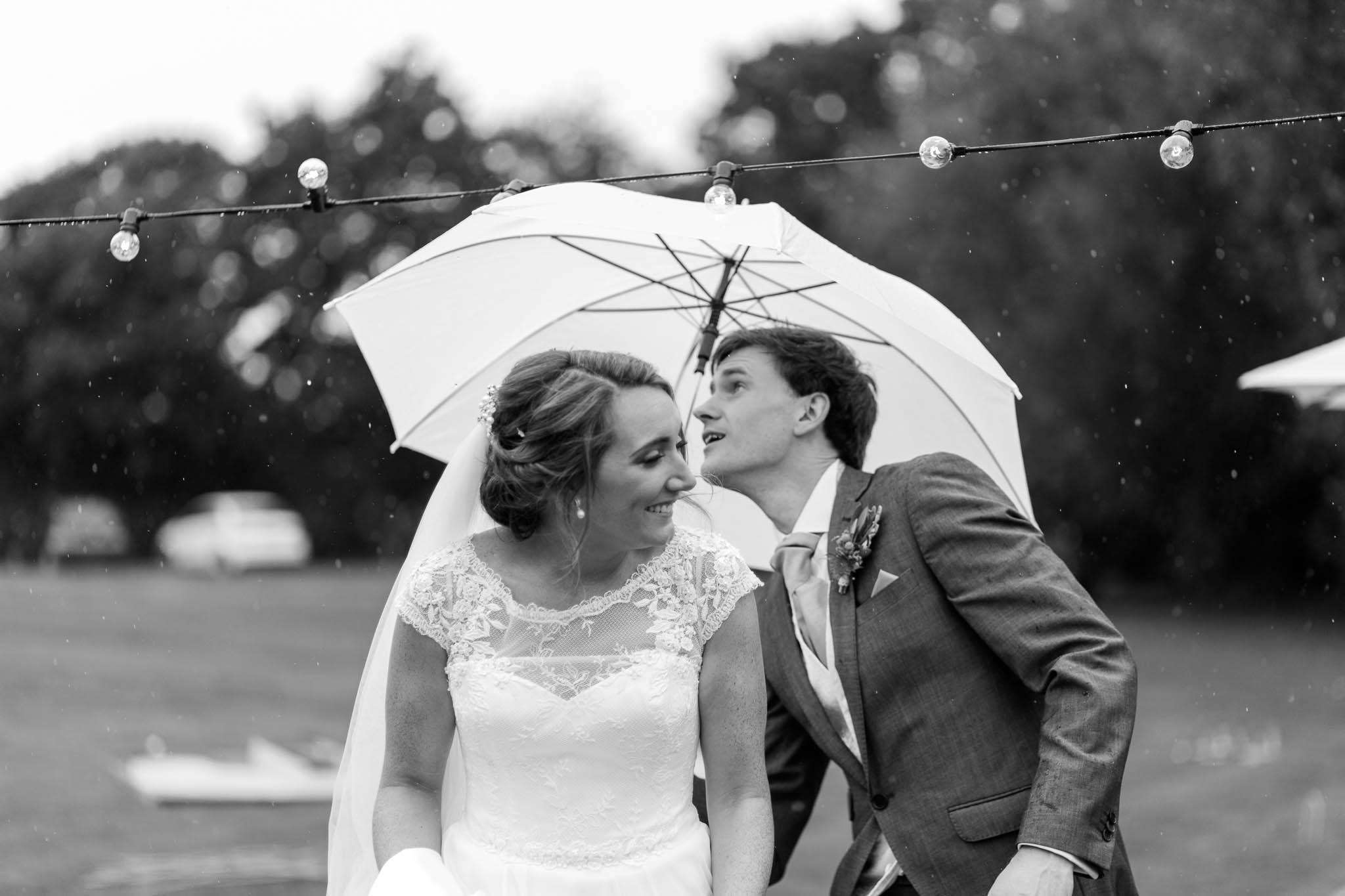 rainy wedding photo with umbrella