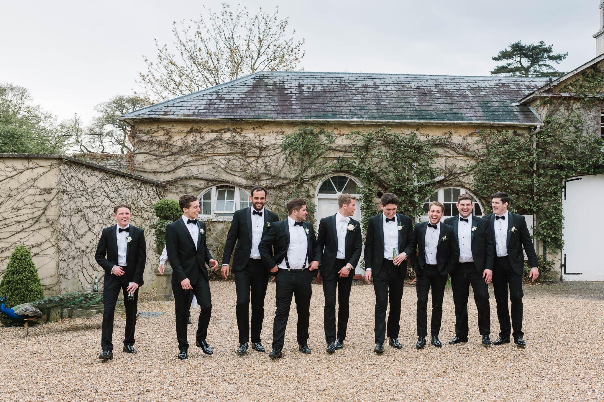 groom and groomsmen walking - elegant and stylish wedding