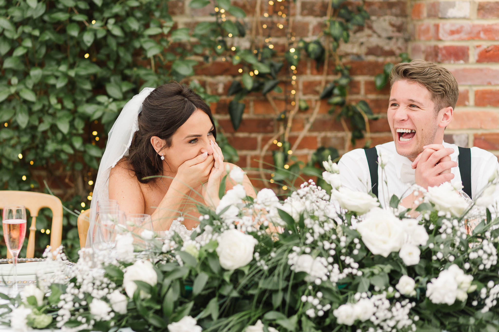 bride and groom laughing at speeches - elegant and stylish wedding