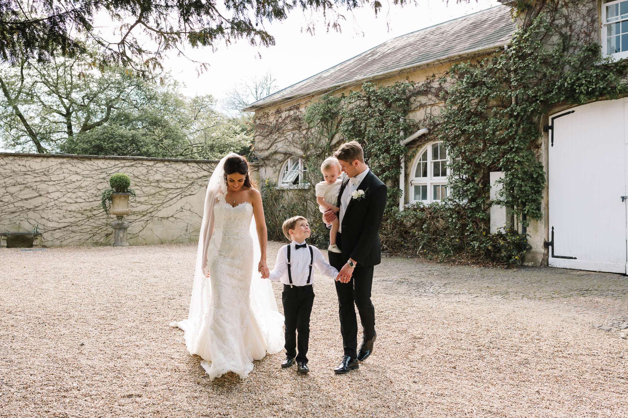 bride and groom with 2 children