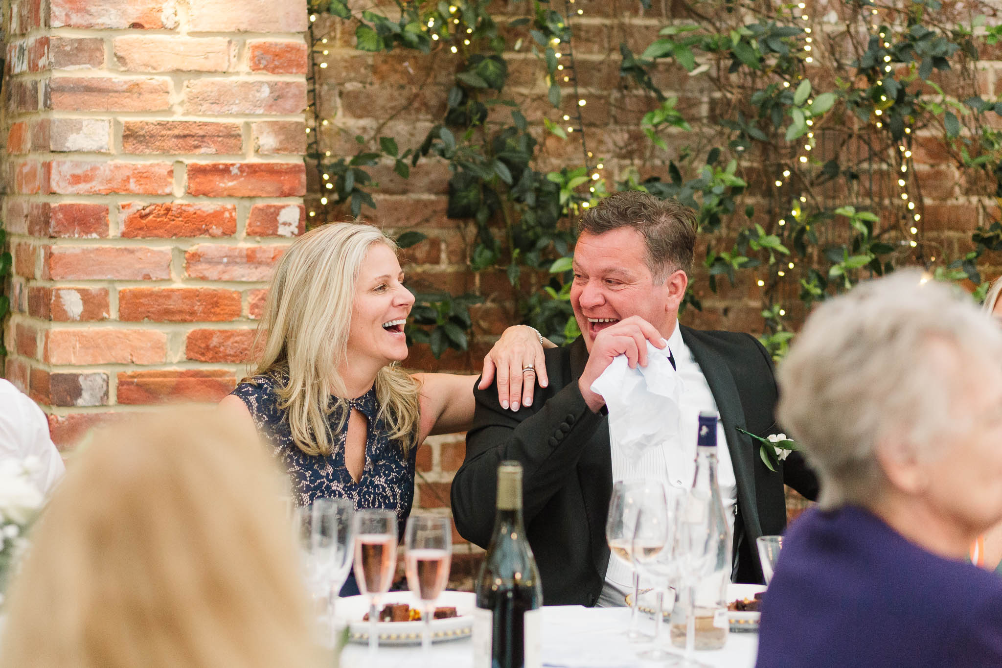 parents laughing at wedding speeches